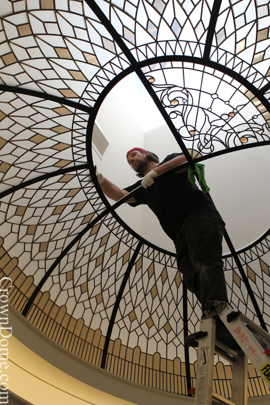 oval stained and leaded glass dome with jewels and beveled glass installation in progress