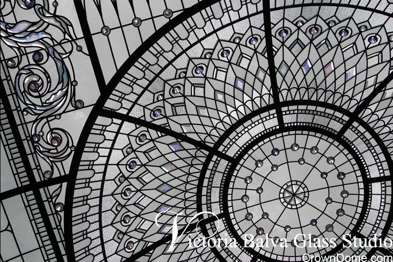 Detail of stained and leaded glass luxury ceiling dome with delicate elusive colors of hand bevelled glass elements and crystal jewels in combination with milky white Youghiogheny glass