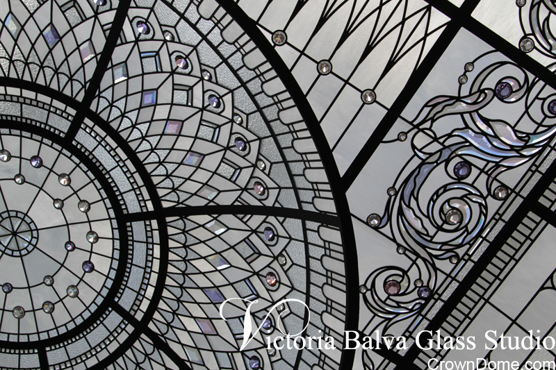 Close up detail of leaded glass luxury raised and domed ceiling  with delicate elusive colors of custom made glass elements and accent crystal jewels  for a private residence in Connecticut