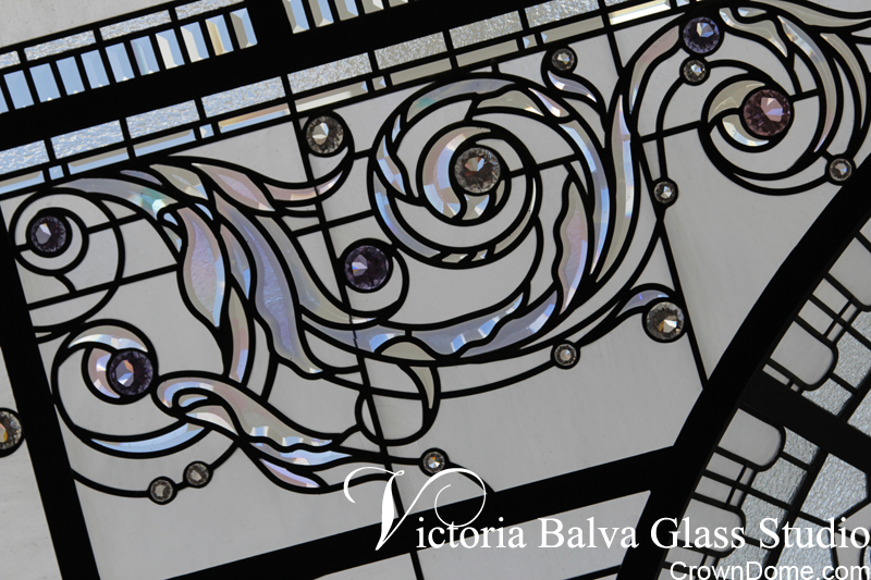 Close up detail of custom hand bevelled glass ornament for a leaded glass dome