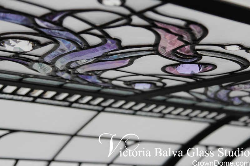 Delicate elusive colors of kiln formed, water jet cut and hand beveled glass elements in combination of accent crystal jewels for a private residence in Connecticut