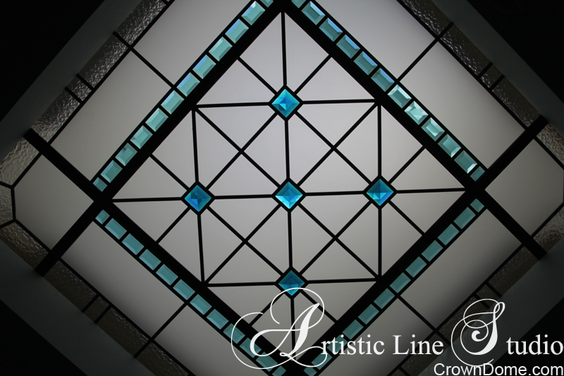 Small leaded glass octagon skylight with turquoise bevelled glass and crystal jewels a foyer of a private residencenin Kitchener