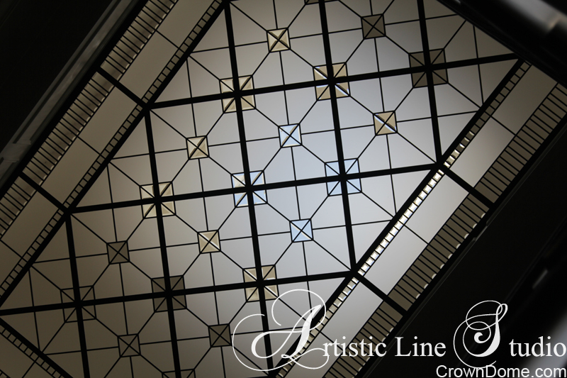 Details of installed leaded glass skylight ceiling with clear glass accents. Simple geometry