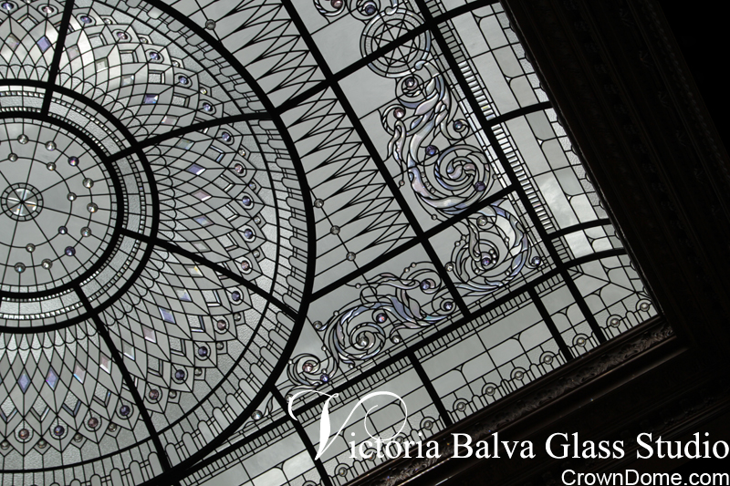 Large raised and domed stained and leaded glass dome with delicate elusive colors of hand bevelled glass and crystal jewels for a library of a provare residence in Connecticut
