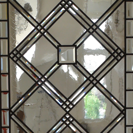 stained and leaded glass classical style window with beveled and antique glass