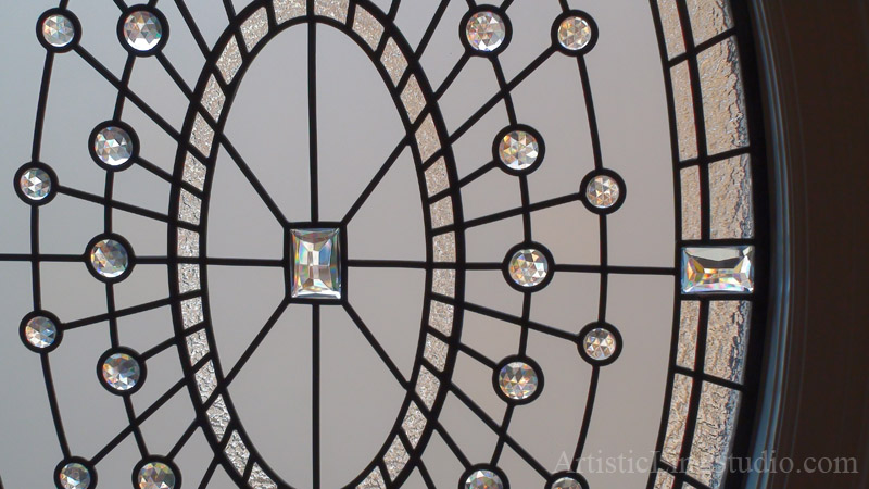 Leaded glass window detail with crystal jewels and clear textured glasses