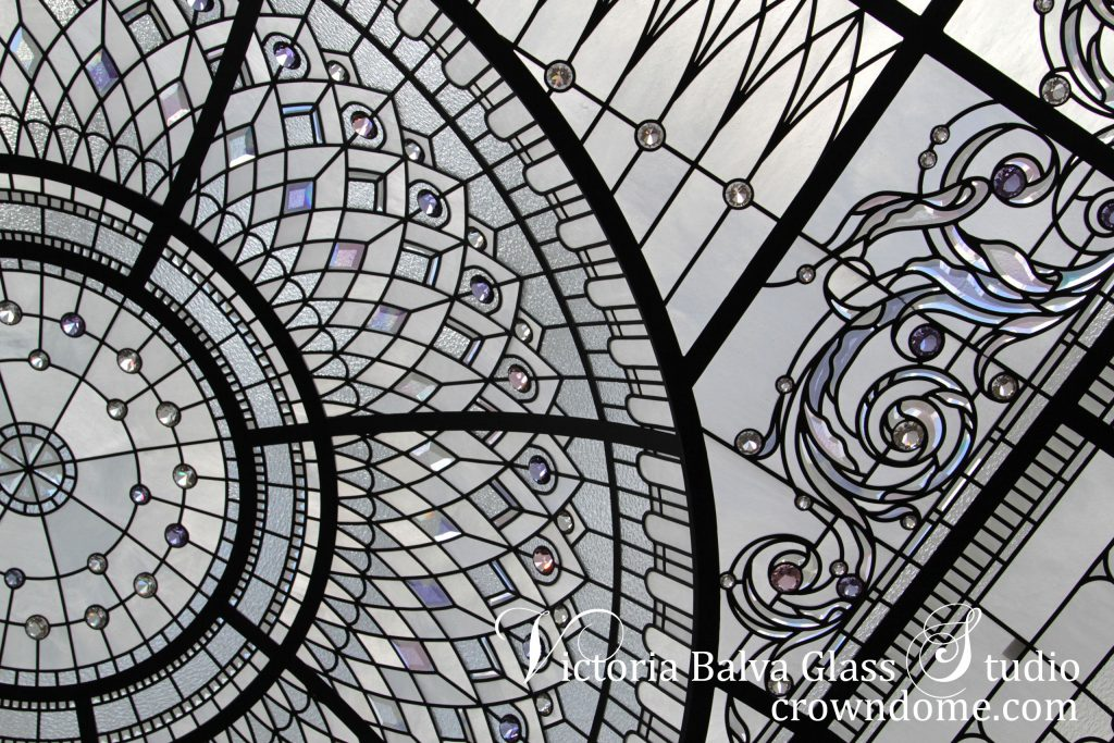 Stained glass domed ceiling with delicate elusive colors of custom beveled glass ornament design