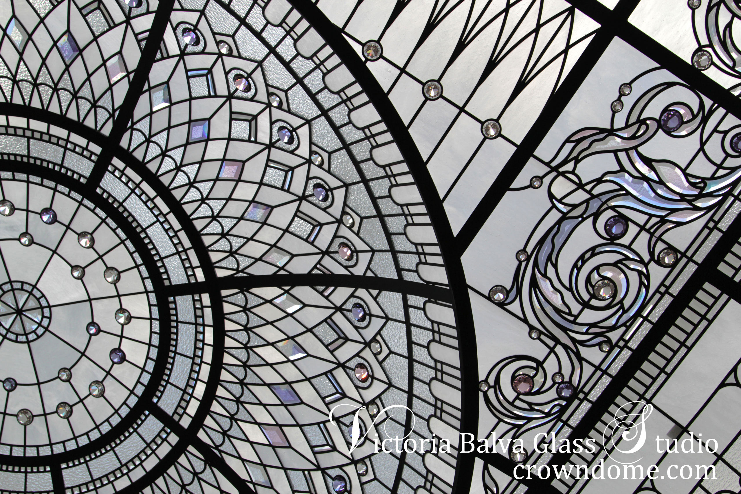 Stained leaded glass domed ceiling with delicate elusive colors of custom beveled glass ornament design