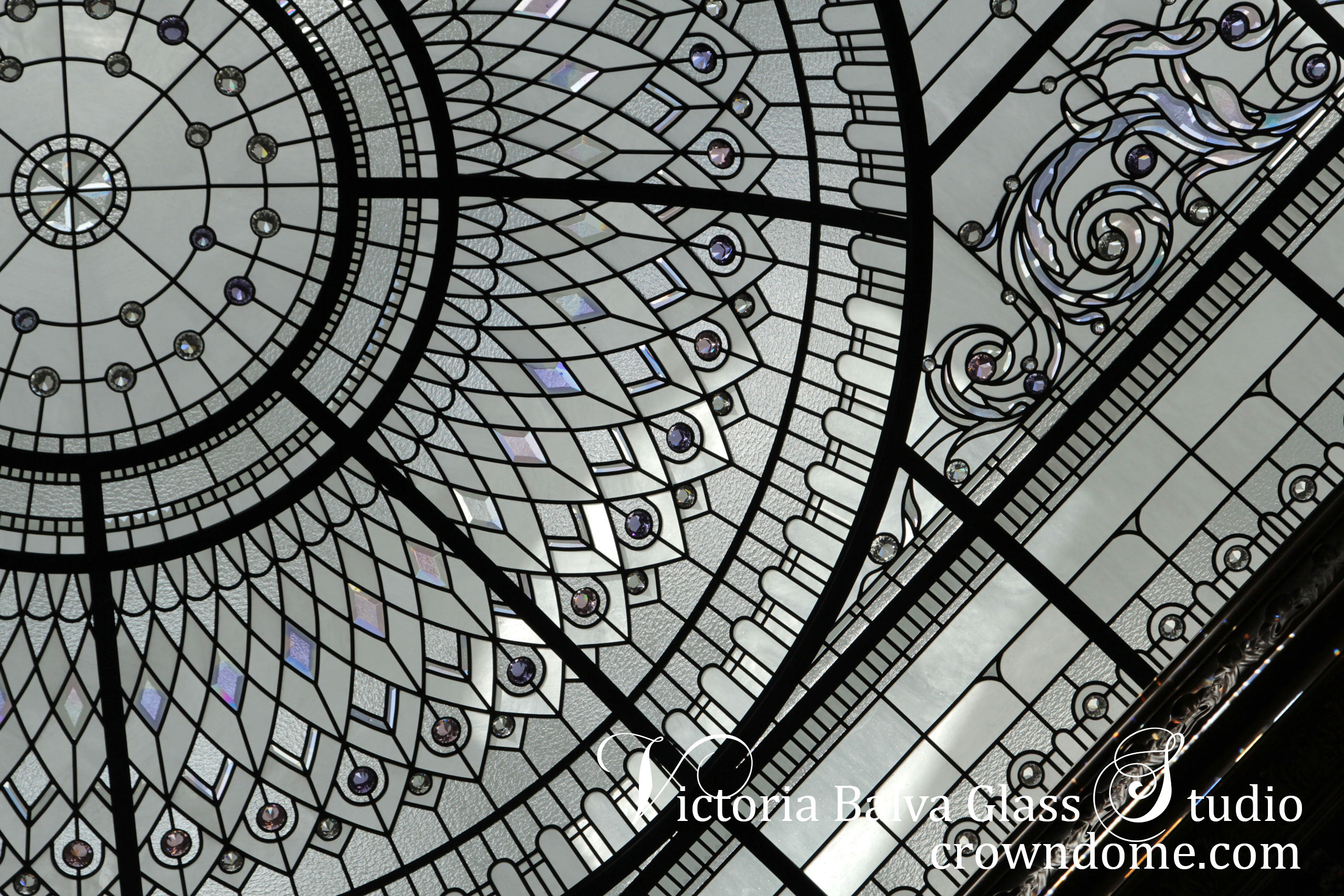stained and leaded glass dome with delicate elusive colors of custom beveled glass and accent crystal jewels