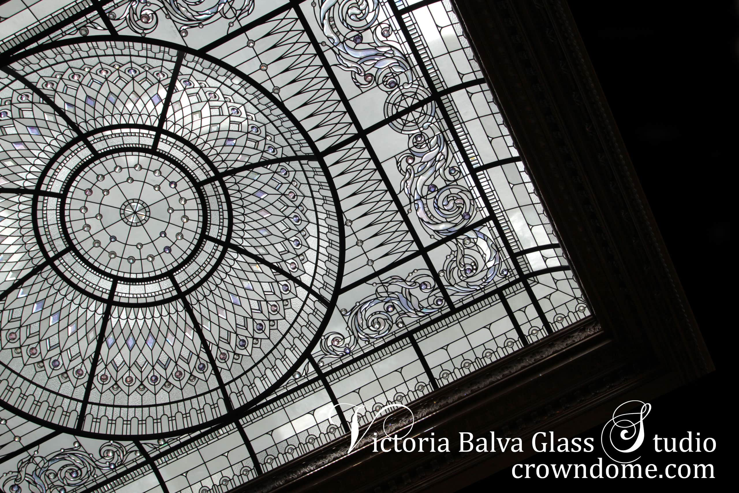 Stained and leaded glass dome skylight intricate design in large scale for a custom built residence with glass dome and curved borders