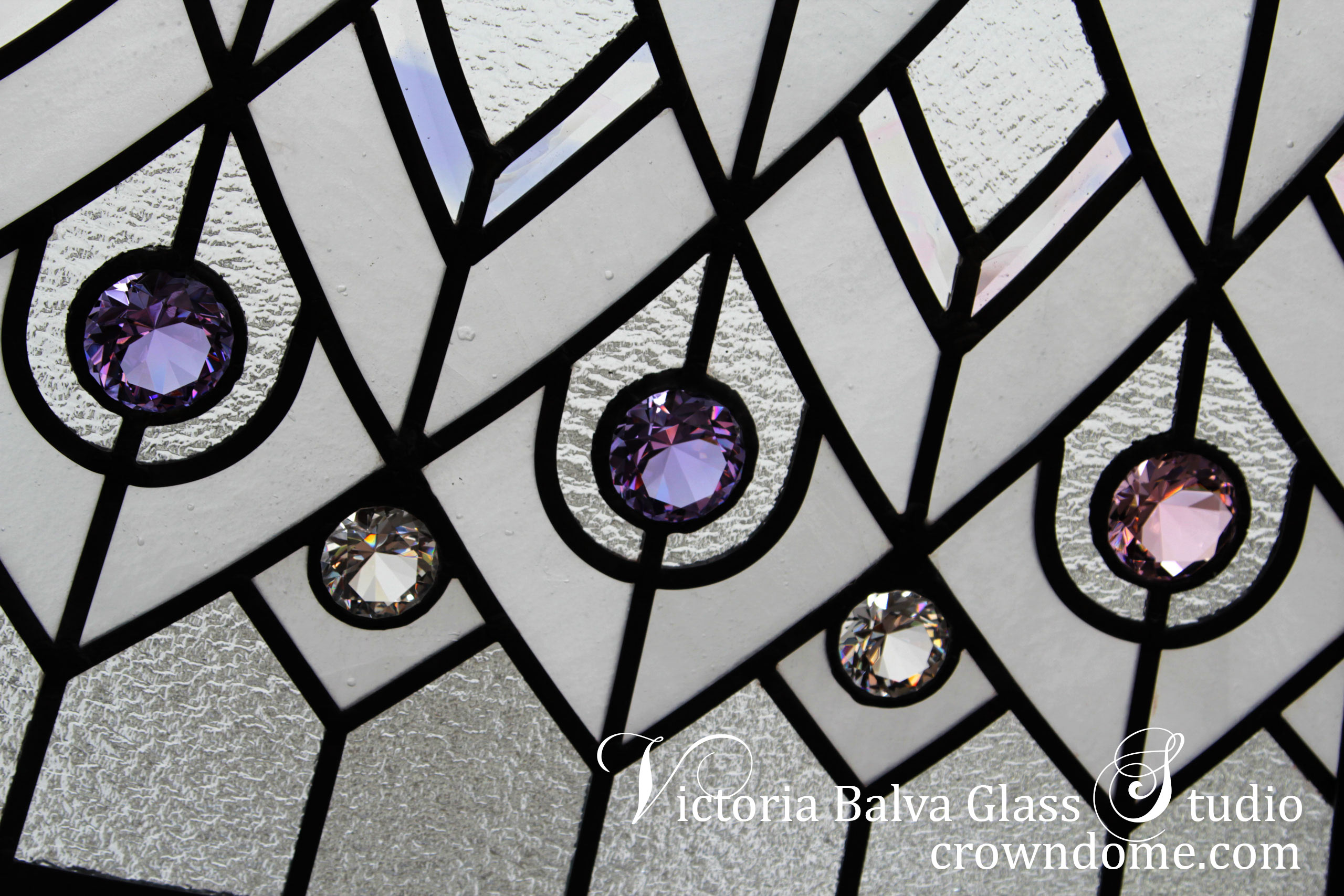 Stained and leaded glass dome detail with large crystal jewels and custom made beveled glass with delicate elusive colors
