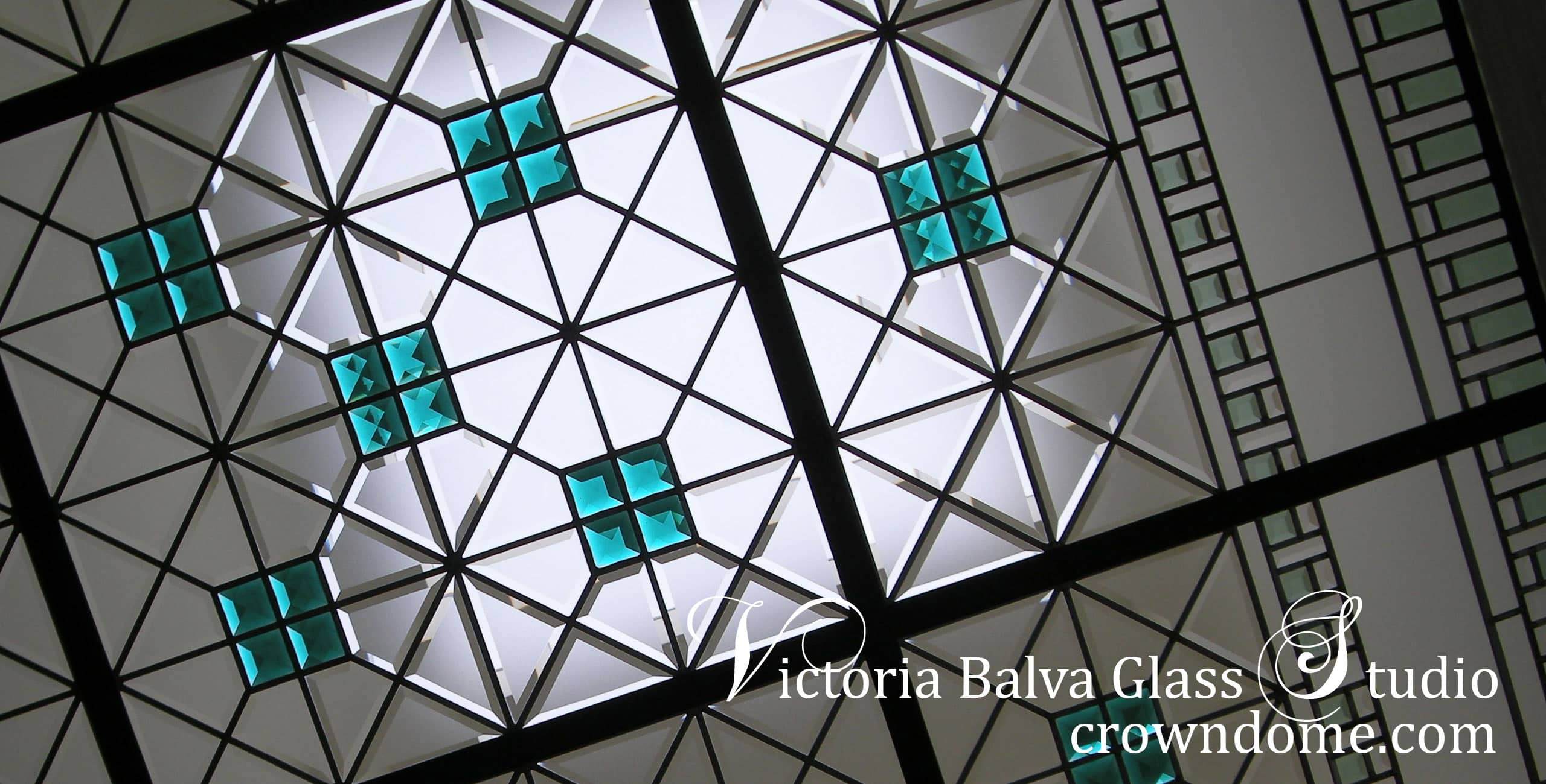 Beautiful contemporary stained leaded beveled glass ceiling design with custom beveled glass and large accent emerald jewels by stained glass artist Victoria Balva. Minimalist stained beveled glass ceiling with intricate line work, emerald accent jewels and colored beveled glass for a bathroom of a custom built residence.