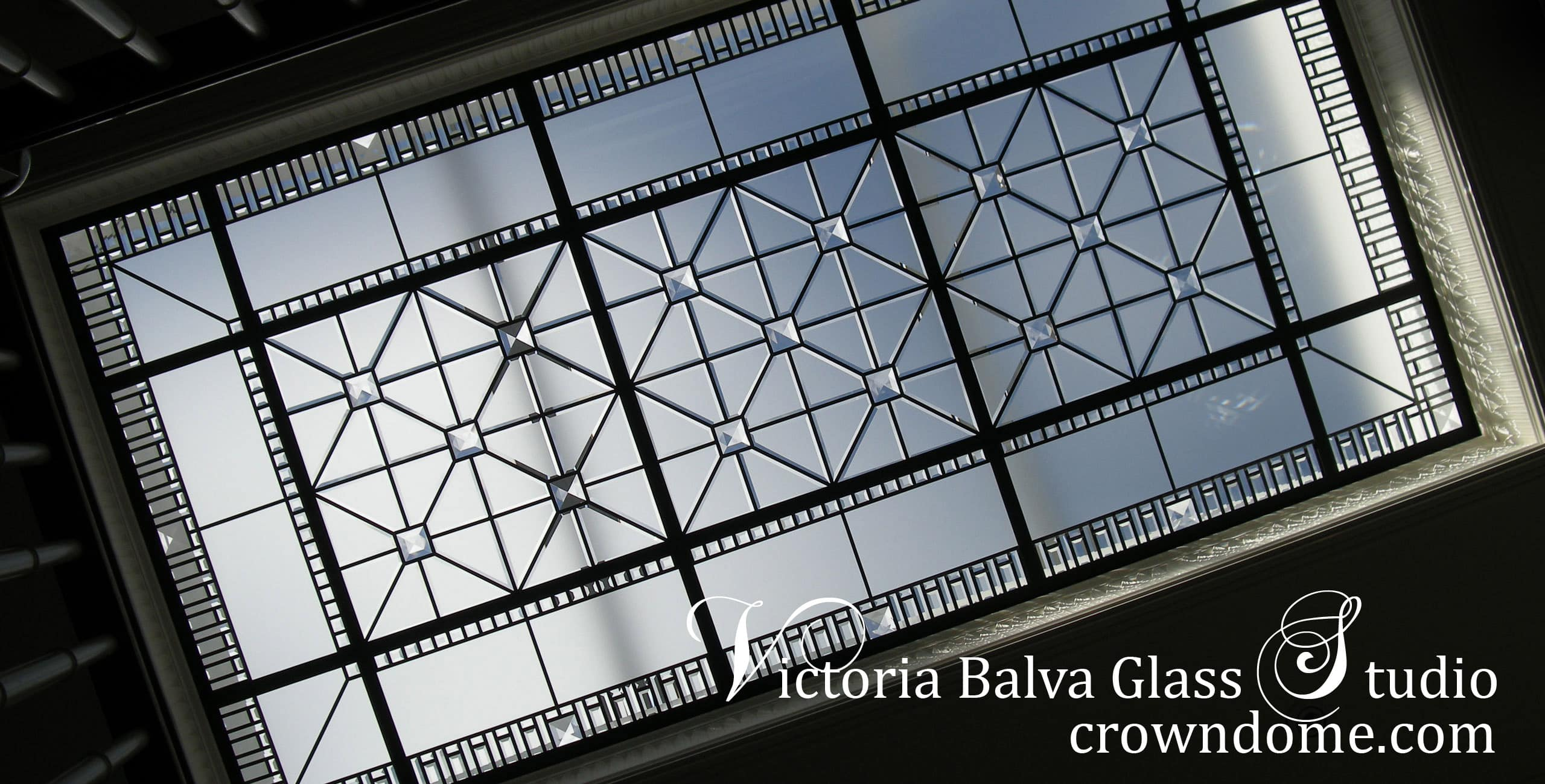 Large beveled leaded glass skylight Amedeo with custom beveling and large crystal jewels in simple geometric style for a hallway of custom built residence in Toronto. Gorgeous beveled leaded glass skylight design by architectural glass artist Victoria Balva