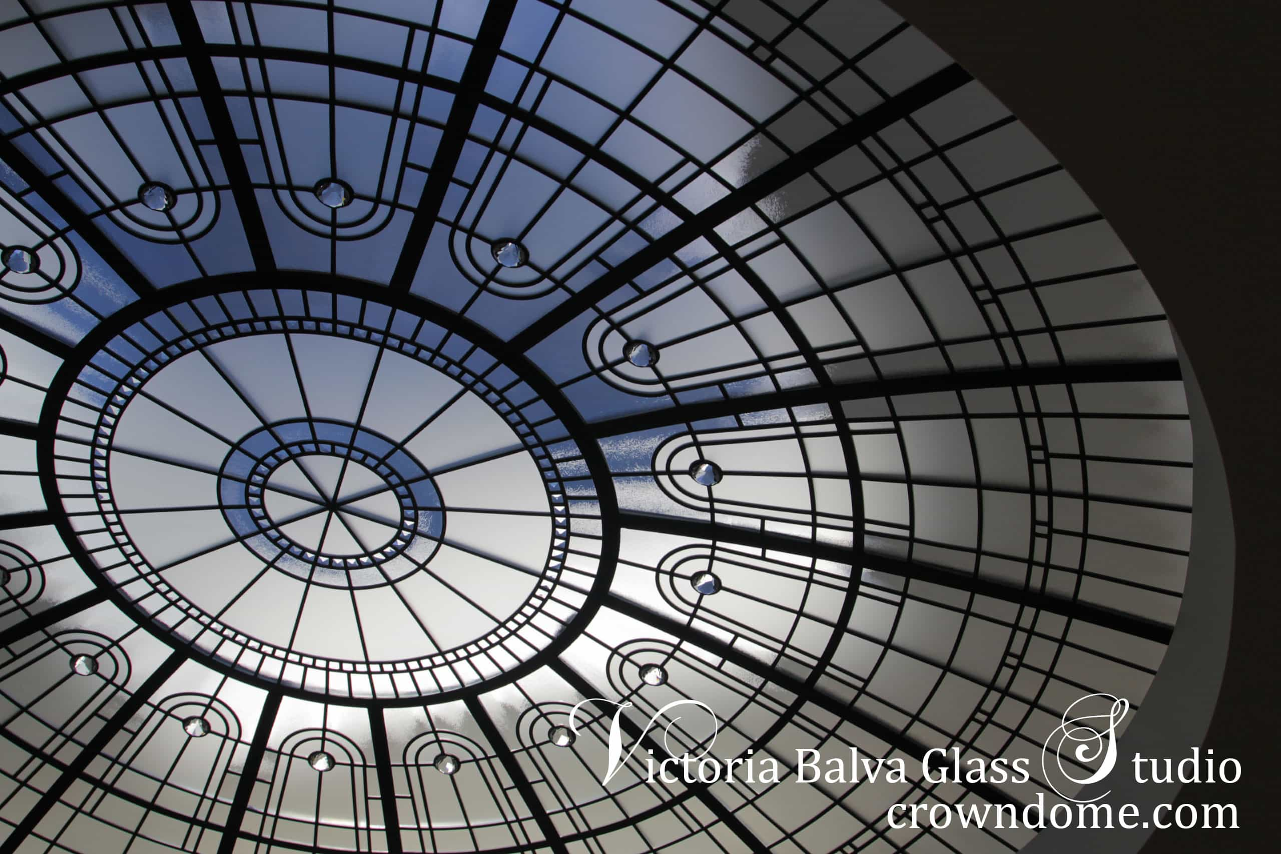 Large stained leaded glass dome design in simple geometrical style with beveled glass, clear textured glasses and crystal accent jewels