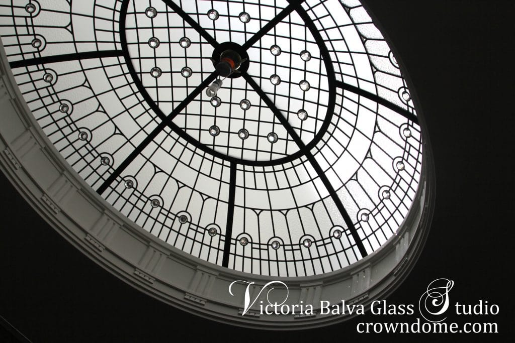 Simple elegant oval leaded glass dome with crystal chandelier hanging from a glass ceiling. Oval leaded glass dome is designed with clear textured glasses, crystal accent jewels in simple and elegant style. Original oval leaded glass dome design by architectural glass artist Victoria Balva