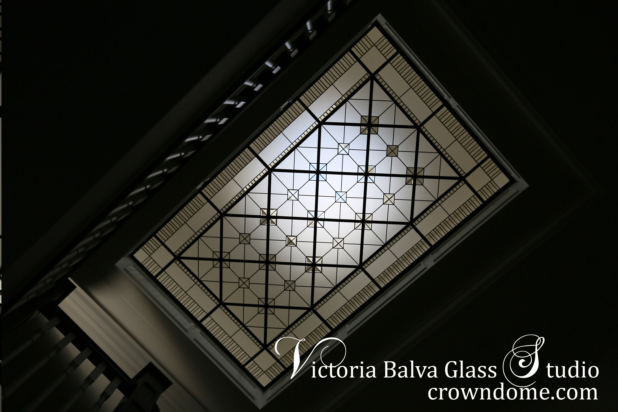 Large geometrical leaded glass skylight with clear beveled glass and clear textured glass for a custom-built house in traditional style. Clear textured glass, beveled glass, intricate line-work geometry. Leaded glass skylight ceiling design by architectural glass artist Victoria Balva