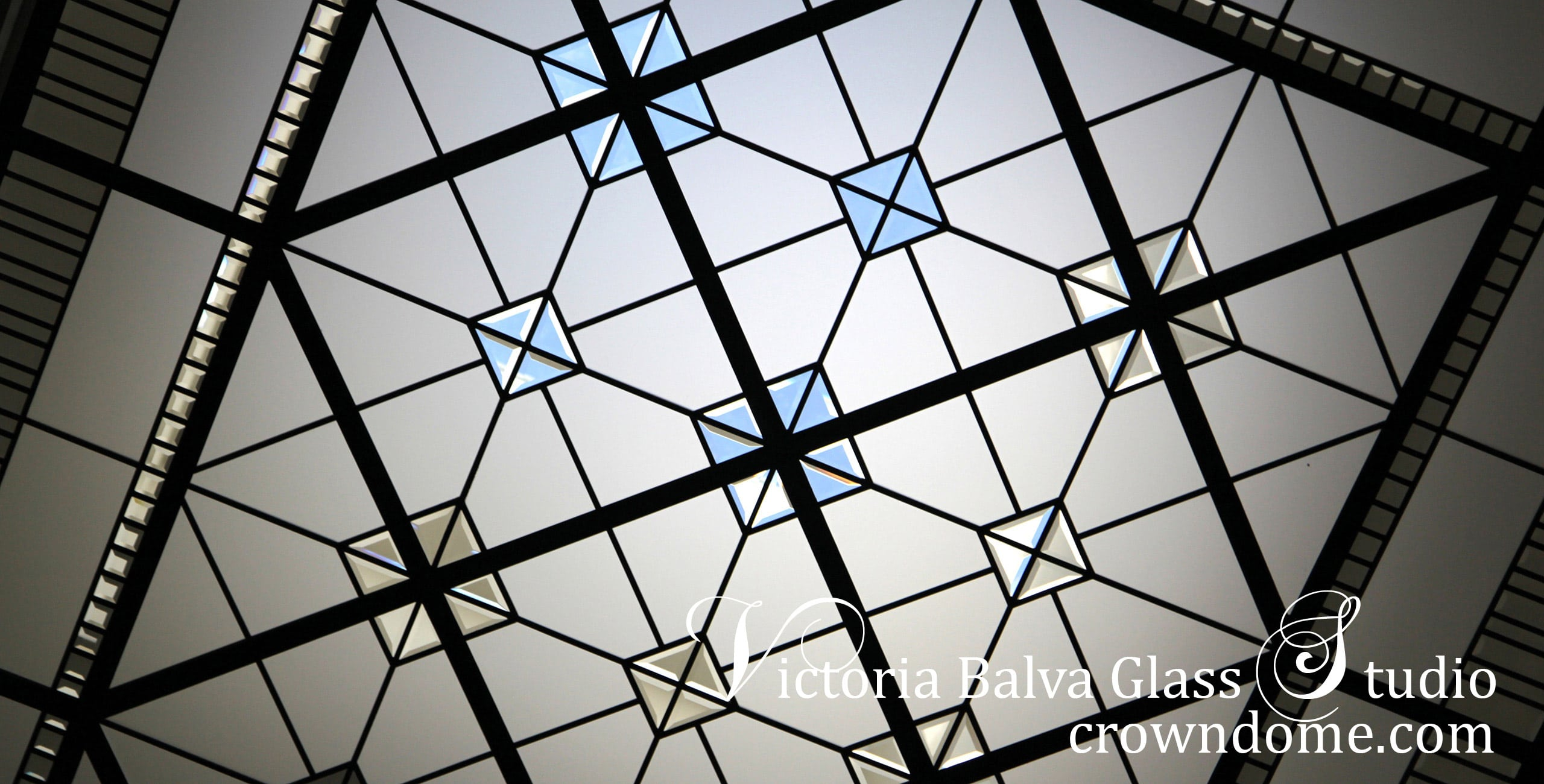 Leaded glass skylight ceiling close-up detail with clear beveled glass and clear textured glass for a custom-built house in traditional style. Clear textured glass, beveled glass, intricate line-work geometry. Leaded glass skylight ceiling design by architectural glass artist Victoria Balva