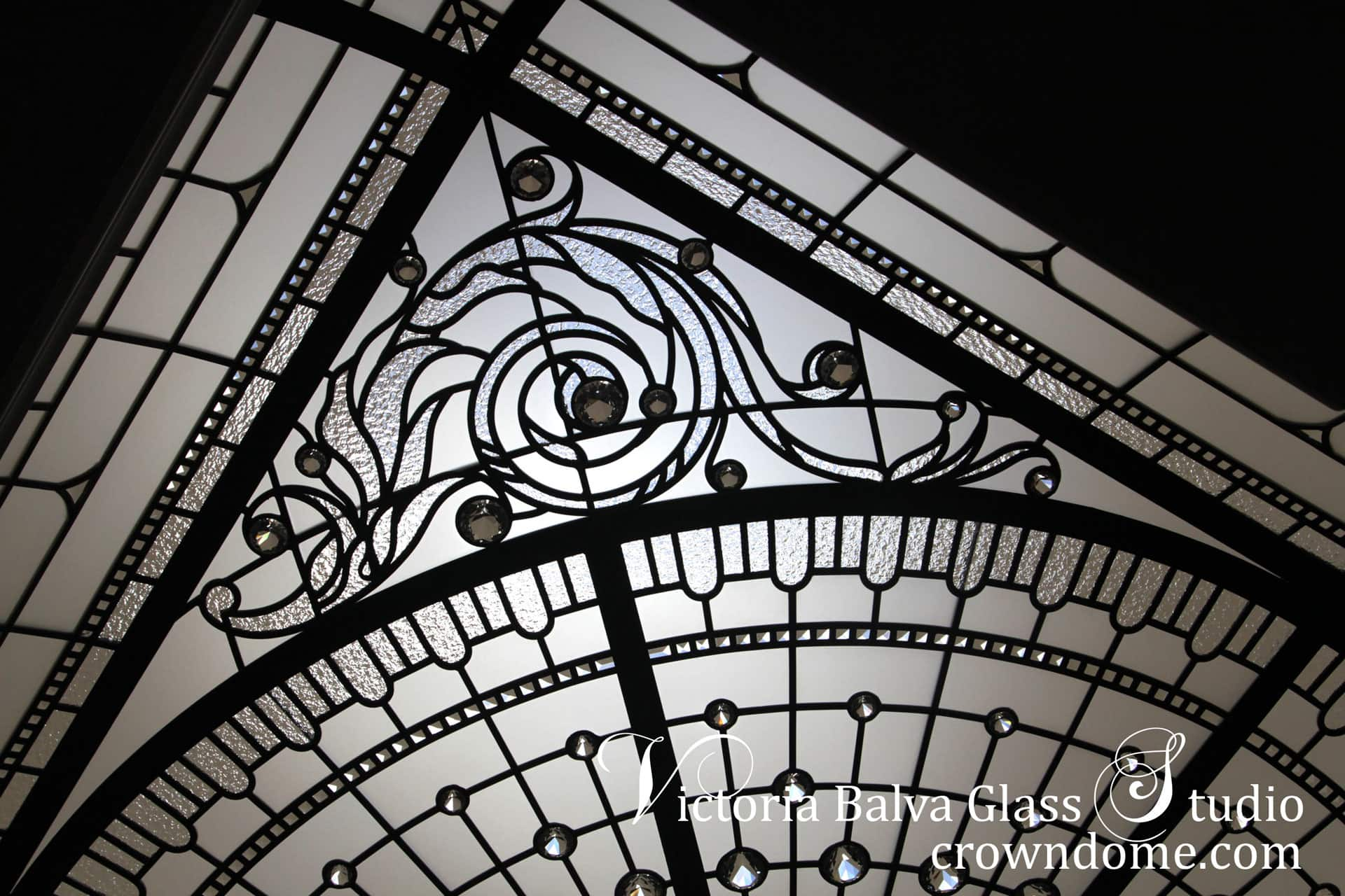Leaded glass ceiling skylight detail with acanthus leaf ornamental borders, crystal jewel diamonds and beveled glass. Traditional ornament inspired historical leaded glass ceiling skylight