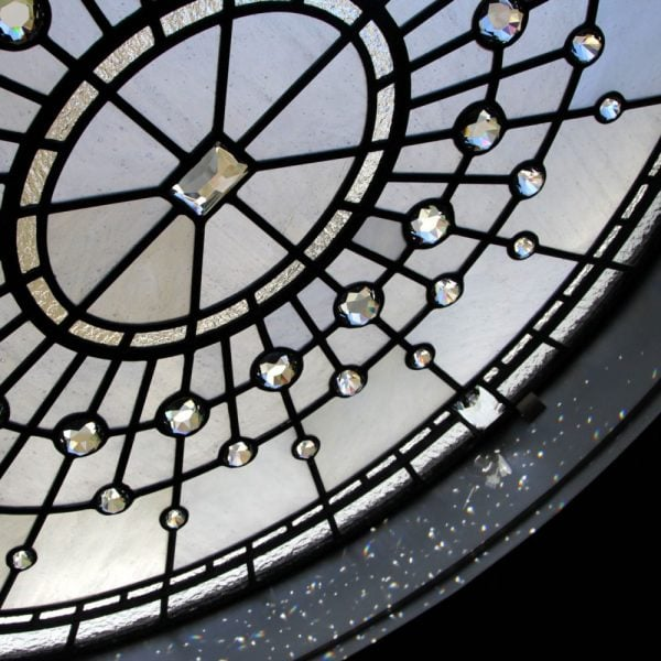 Stained and leaded glass oval window with crystal jewels and clear textured glass