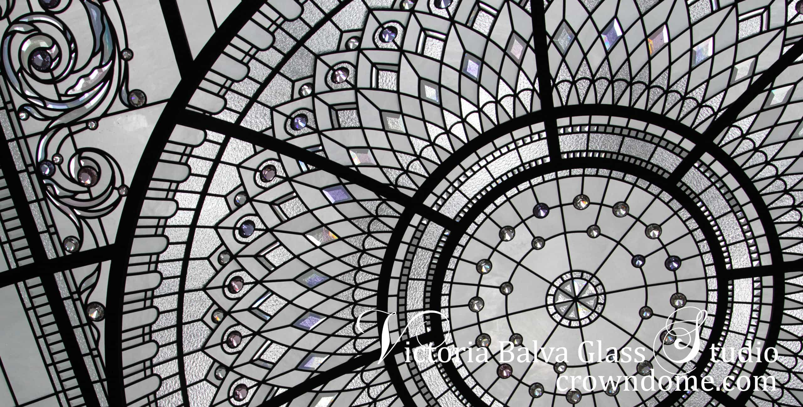 Stained and leaded glass dome skylight ceiling intricate design for a custom built residence . Library decorative glass ceiling