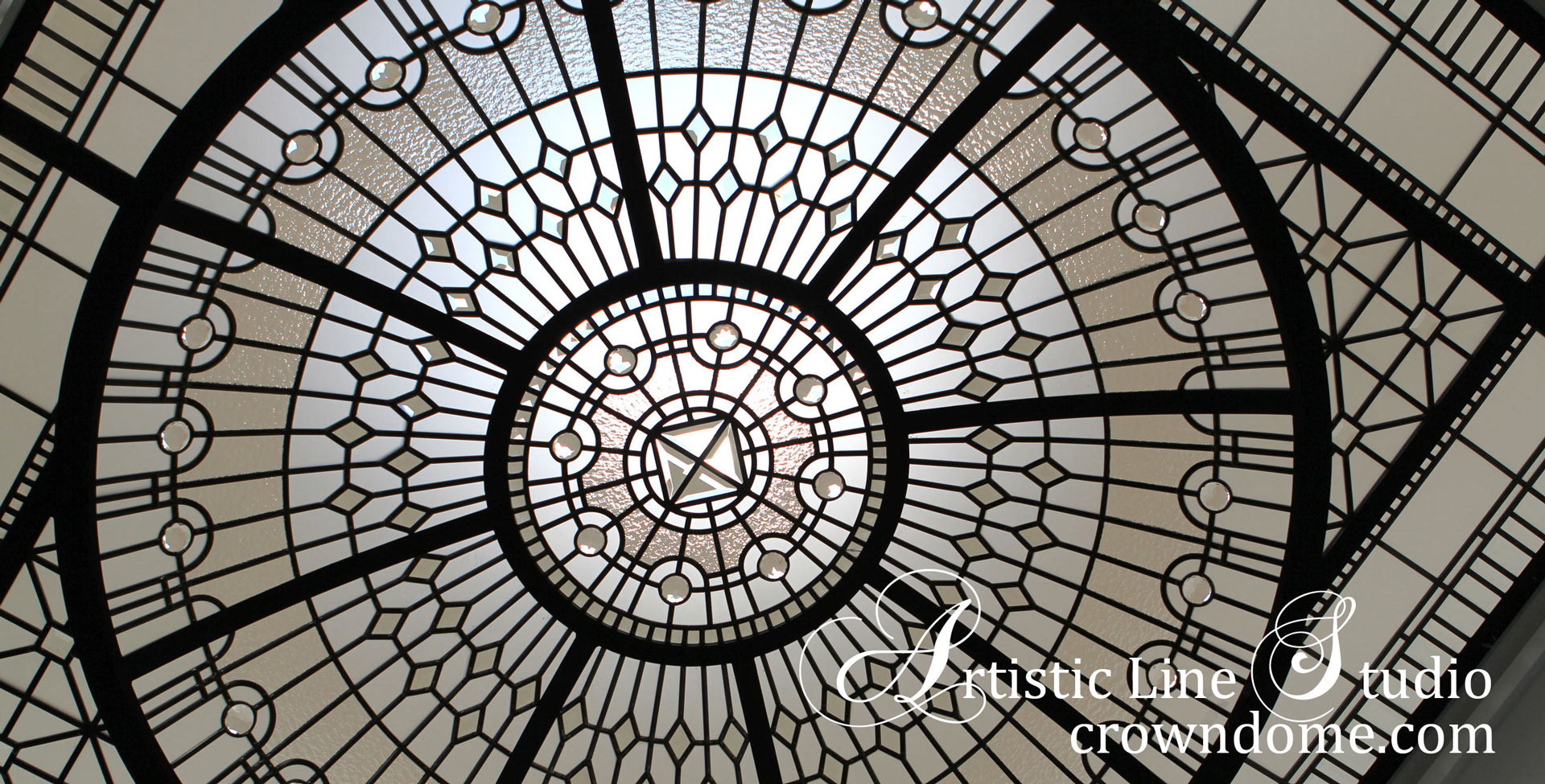 Leaded glass dome design for a bathroom decorative glass ceiling with clear textured glass, large glass jewels, beveled glass in contemporary geometrical design for a bathroom of a custom built house