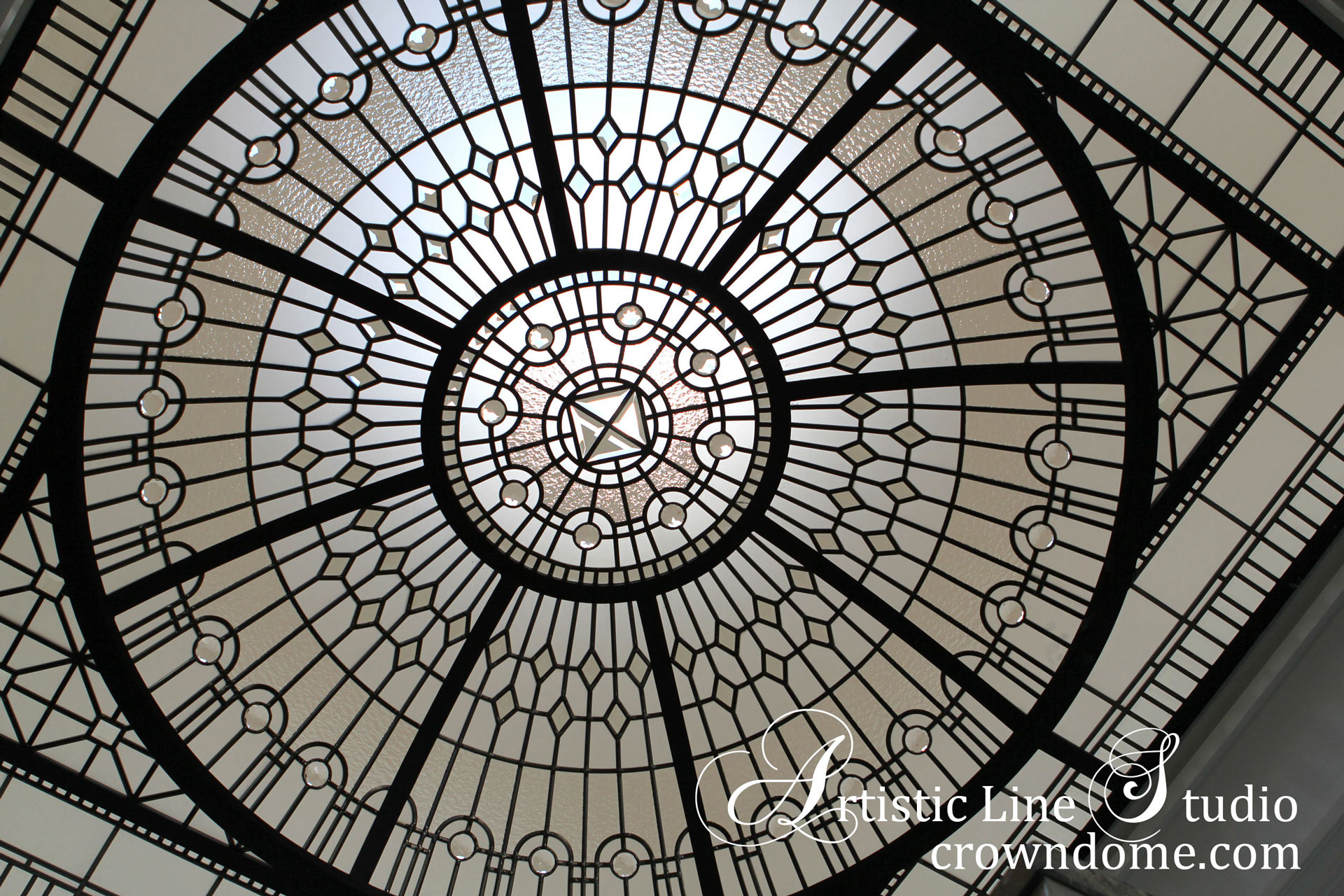 Leaded glass dome design for a decorative glass skylight with clear textured glass, large glass jewels, beveled glass in a modern geometrical design for a bathroom of a custom built house