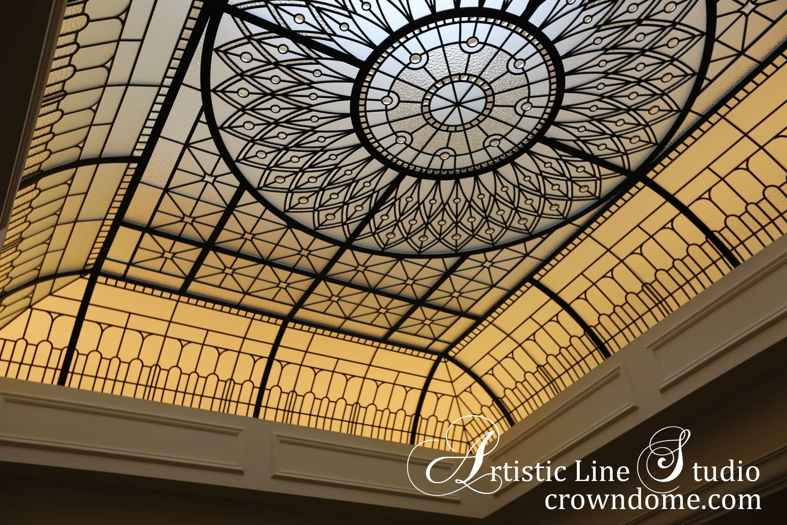 Leaded glass skylight with clear textured glass, bevelled glass and jewels in night lighting. Night illumination emphasizes the glass ceiling beauty