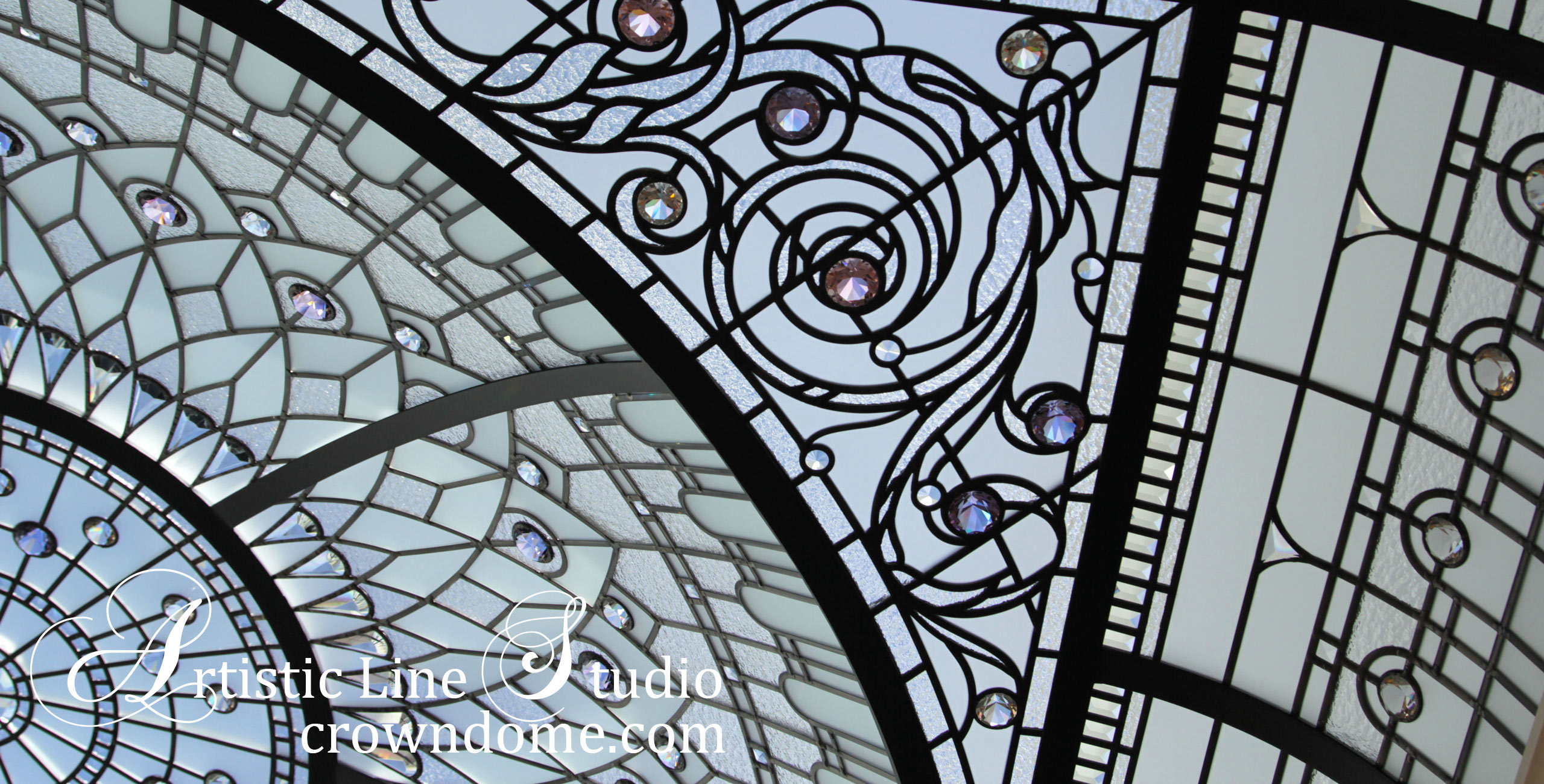 Gorgeous stained and leaded glass domed skylight ceiling for a private residence meditation room with clear textured glass, crystal drops and jewels, hand beveled custom glass. Large complex leaded glass domed ceiling. Stained glass window for the sky