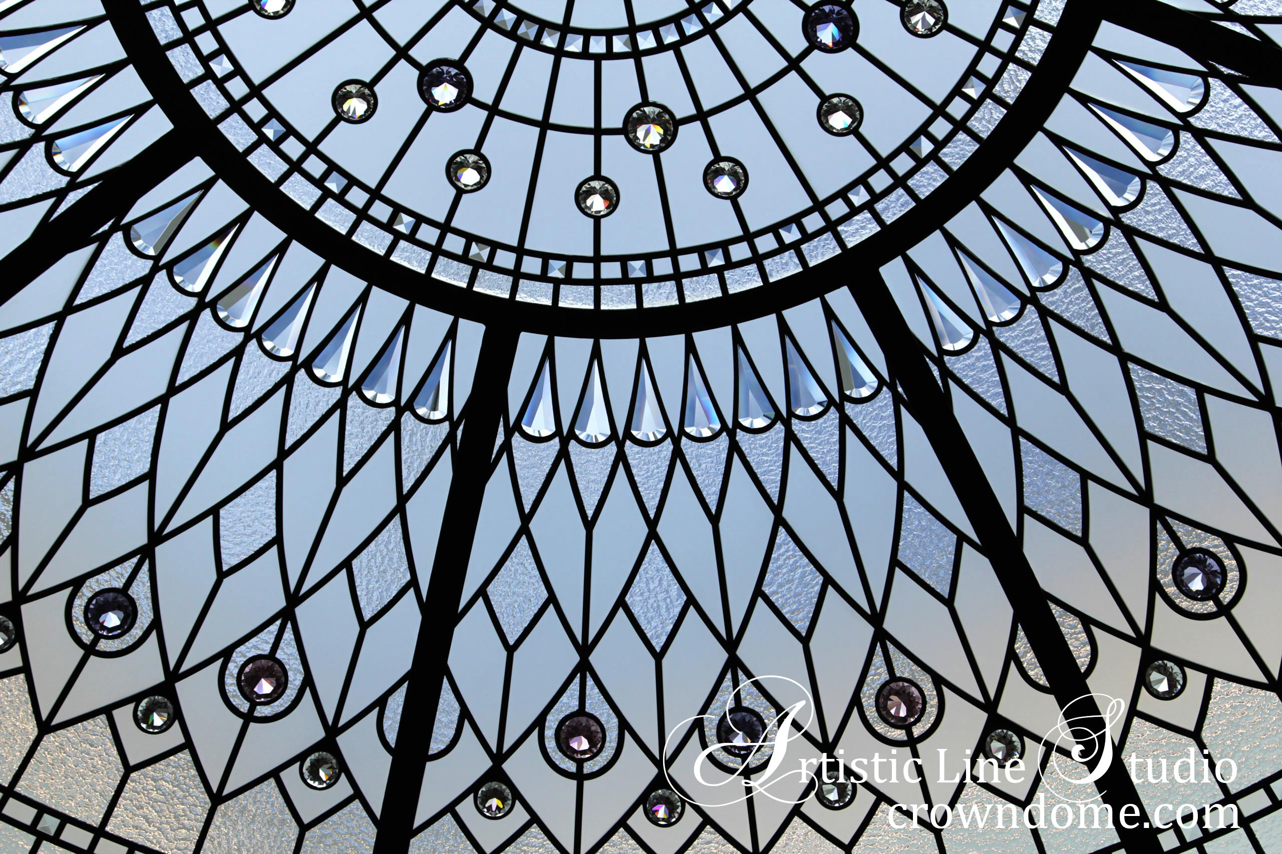 Stained glass dome ceiling with clear and colored crystal jewels, clear textured glasses