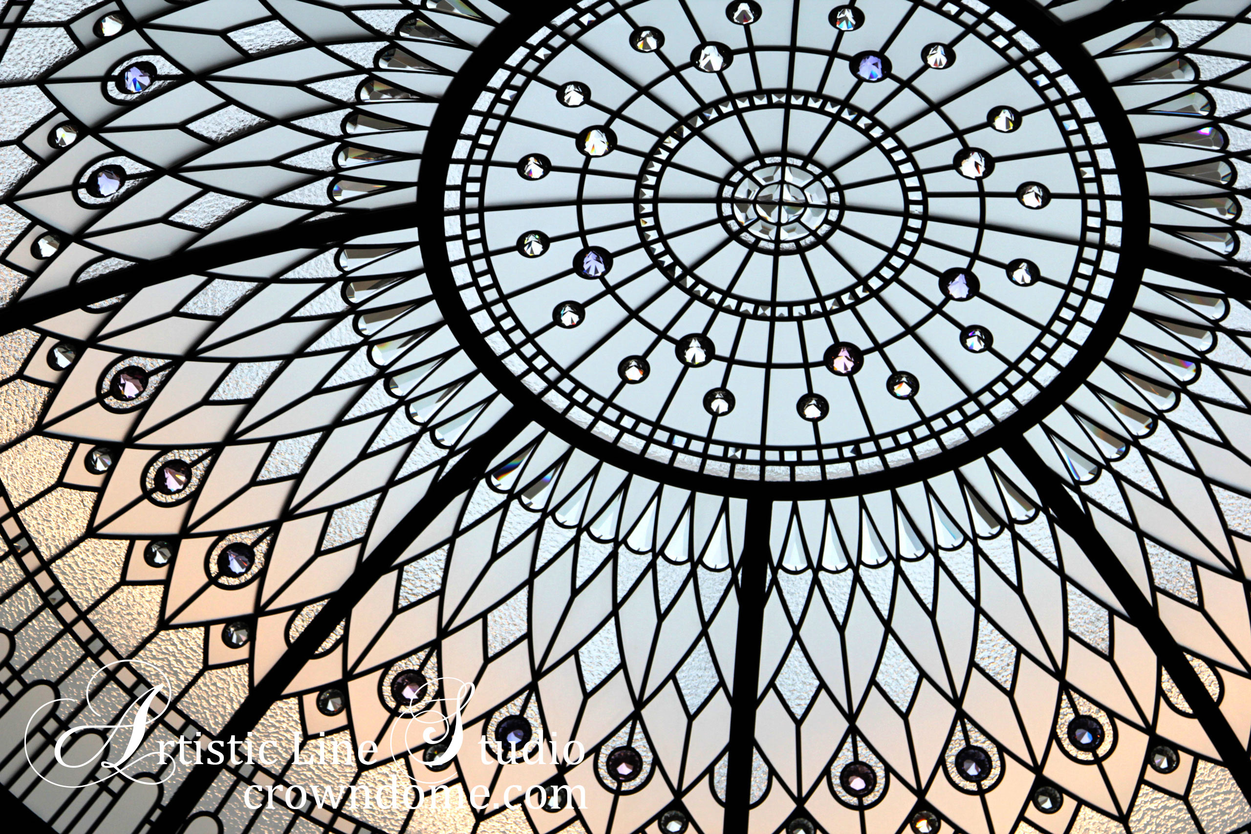 Stained and leaded glass domed ceiling with art glass at a night time