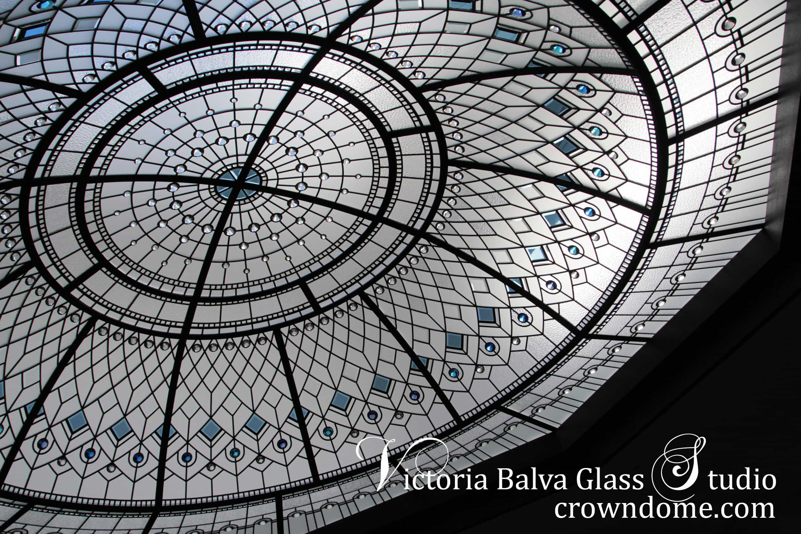Stained glass dome large octagon skylight with hand beveled glass and bright blue, clear and bright turquoise crystal jewels for a custom built residence decorative glass ceiling