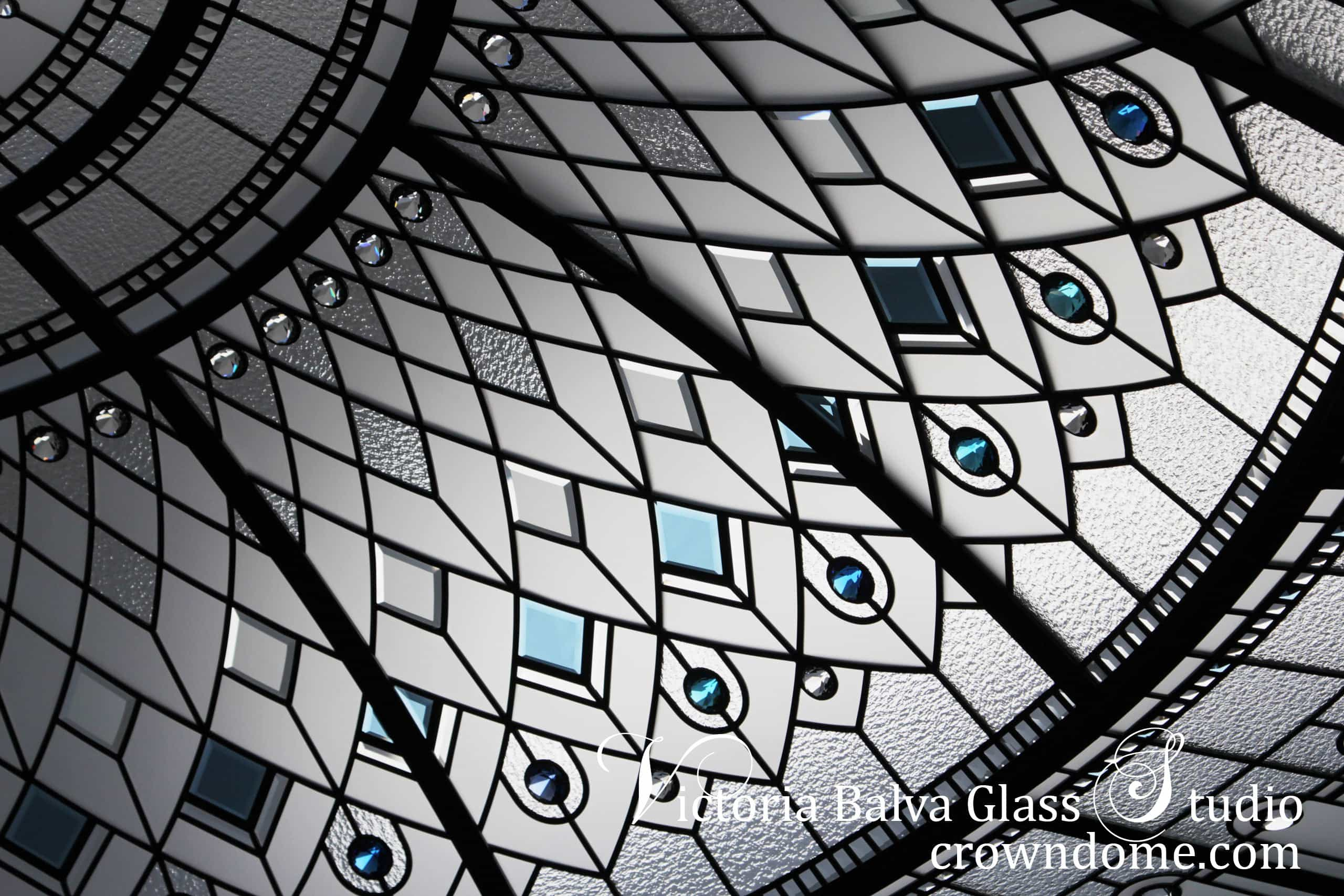 Stained leaded glass dome / octagon glass skylight in geometrical style with colored beveled glass and crystal jewels for a custom build residence decorative glass ceiling