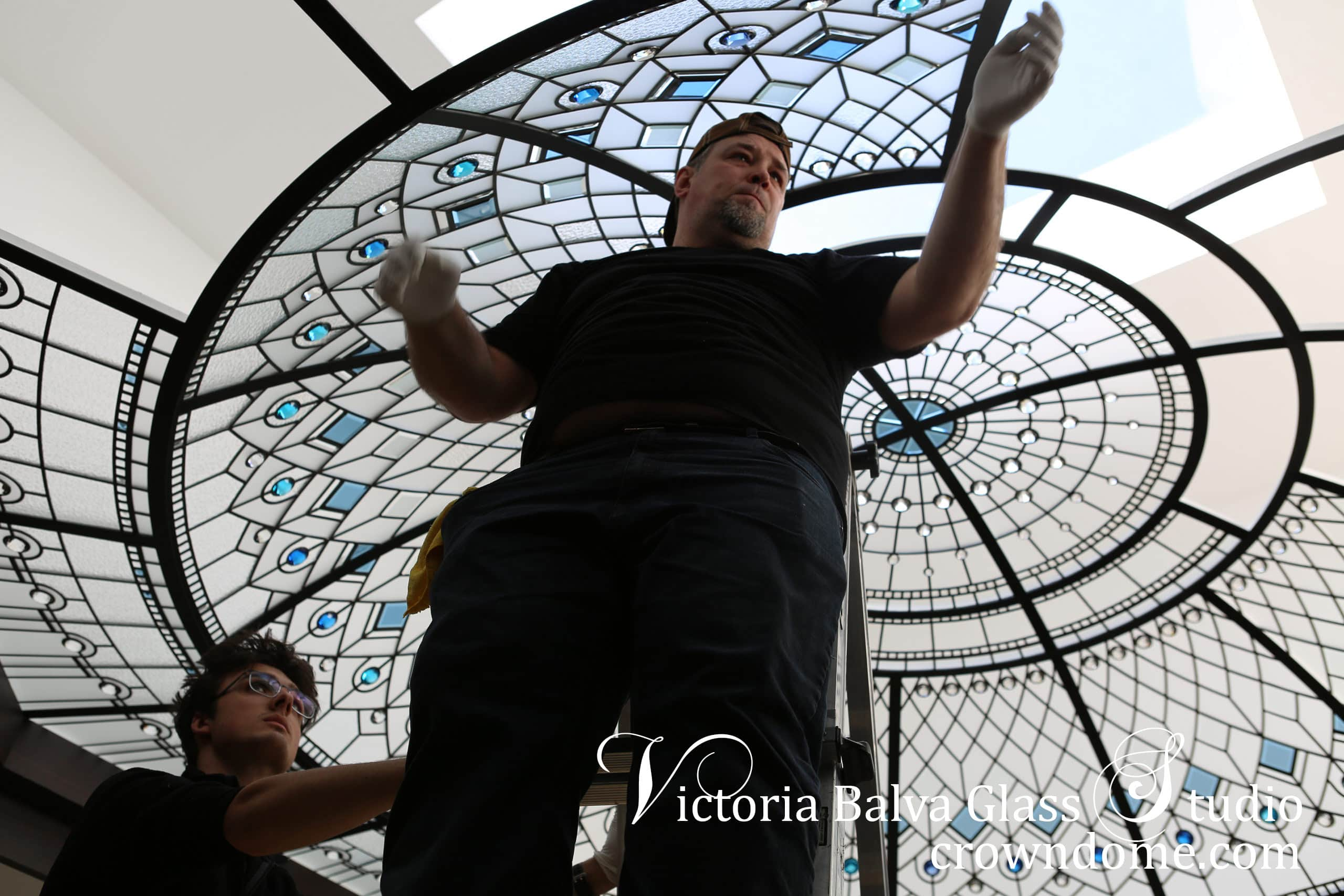 Stained glass dome skylight Blue Lotus with octagon flat border, custom bevelled glass and blue crystal jewel accents. Installation in progress