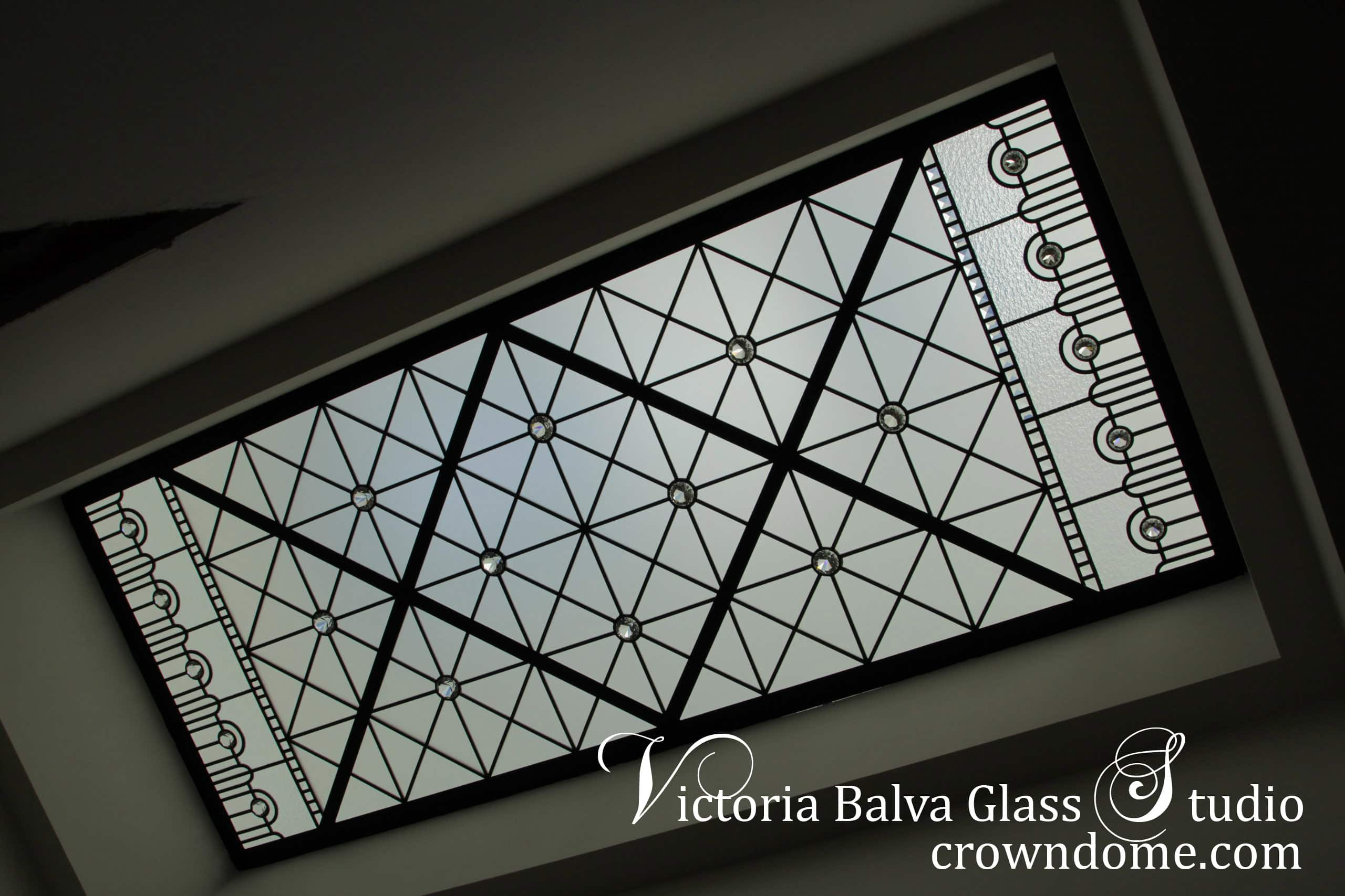Contemporary stained leaded glass skylight ceiling for a hallway of a luxury custom built house with clear textured glasses, beveled glass and clear crystal jewels as accents. The contemporary styling of the glass ceiling design brings modern feeling into space with a reference to a classic design. Leaded glass skylight design by leaded glass artist Victoria Balva