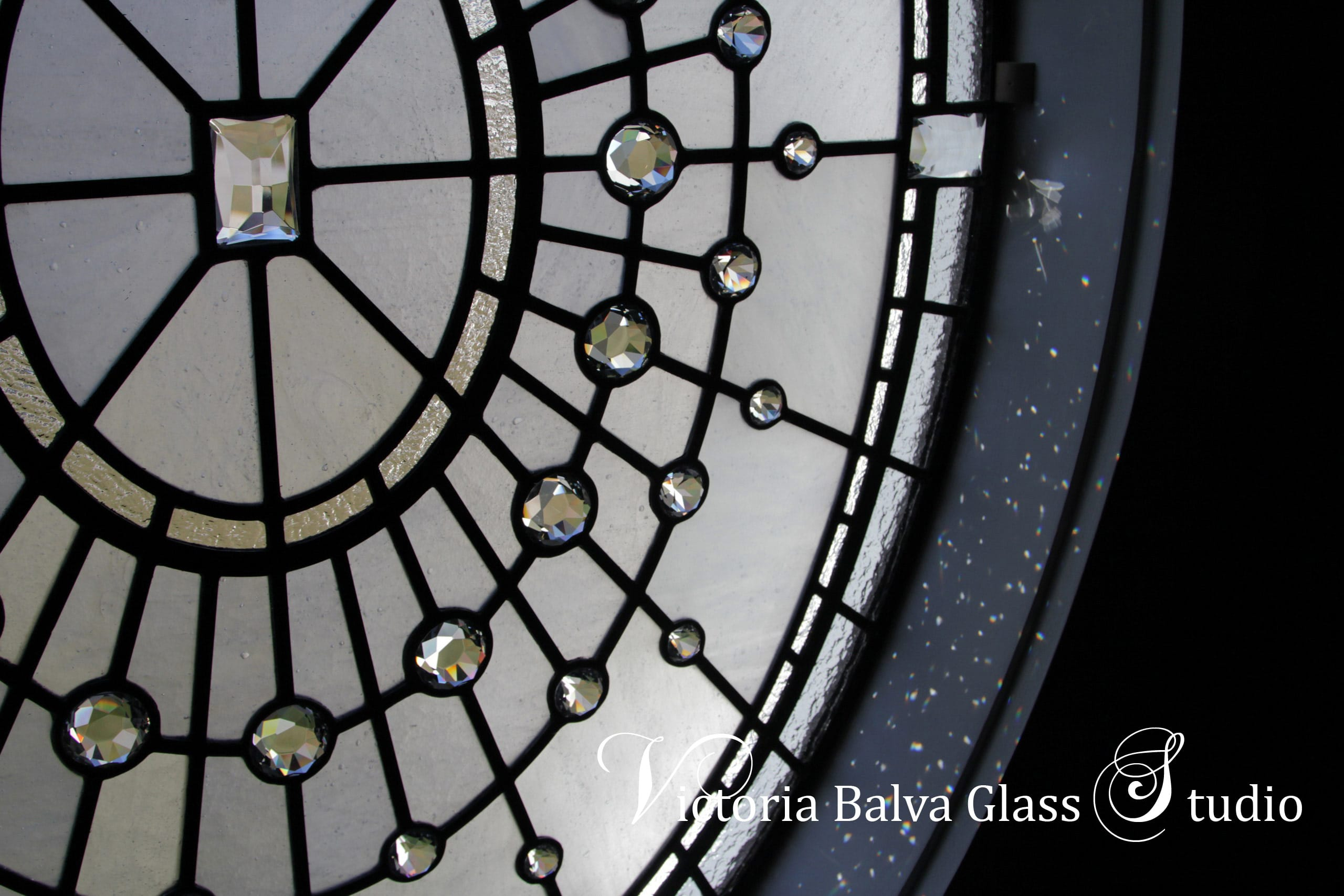 Large oval stained leaded glass window design w crystal jewels for staircase of custom built residence in Washington DC. Glass diamonds refract the light into many tiny rainbows. Clear textured glass, various size glass diamonds. Stained leaded glass oval window design by glass artist Victoria Balva
