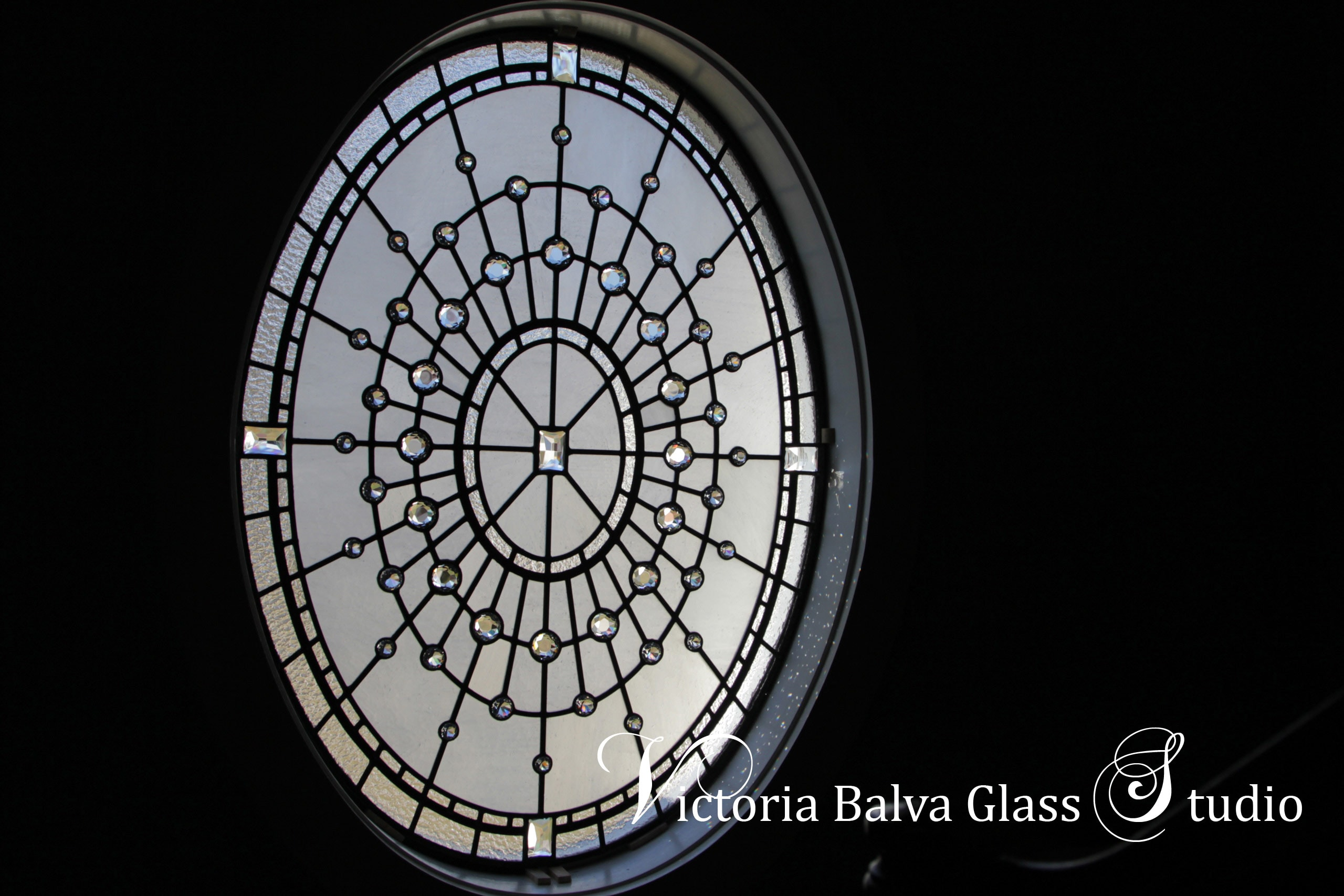 Spectacular large oval stained leaded glass window for a stair landing of a custom built residence