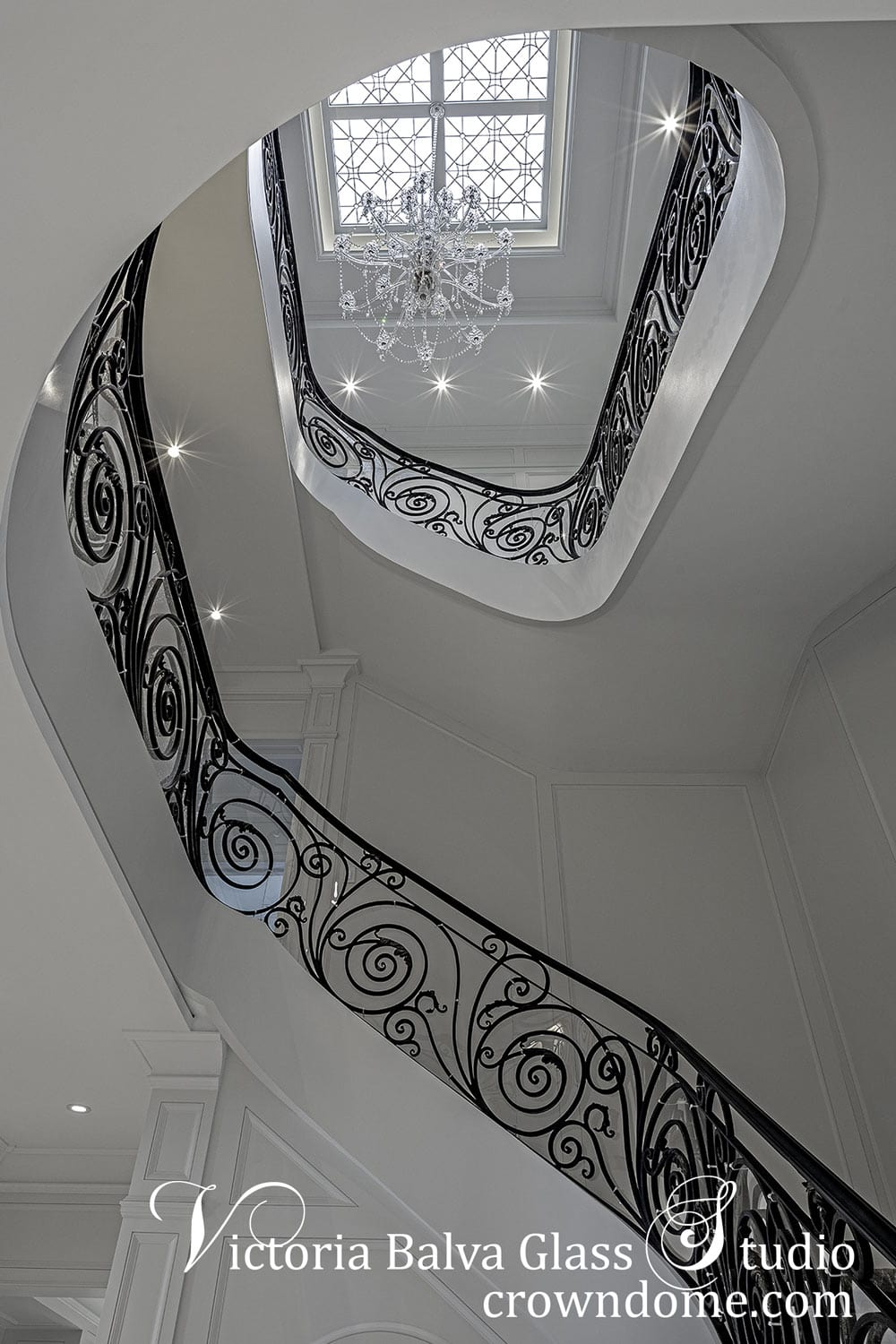 View from the first floor. arge leaded glass skylight ceiling with hand bevelled glass and crystal jewels above the staircase with chandelier for a custom built luxury residence in Toronto