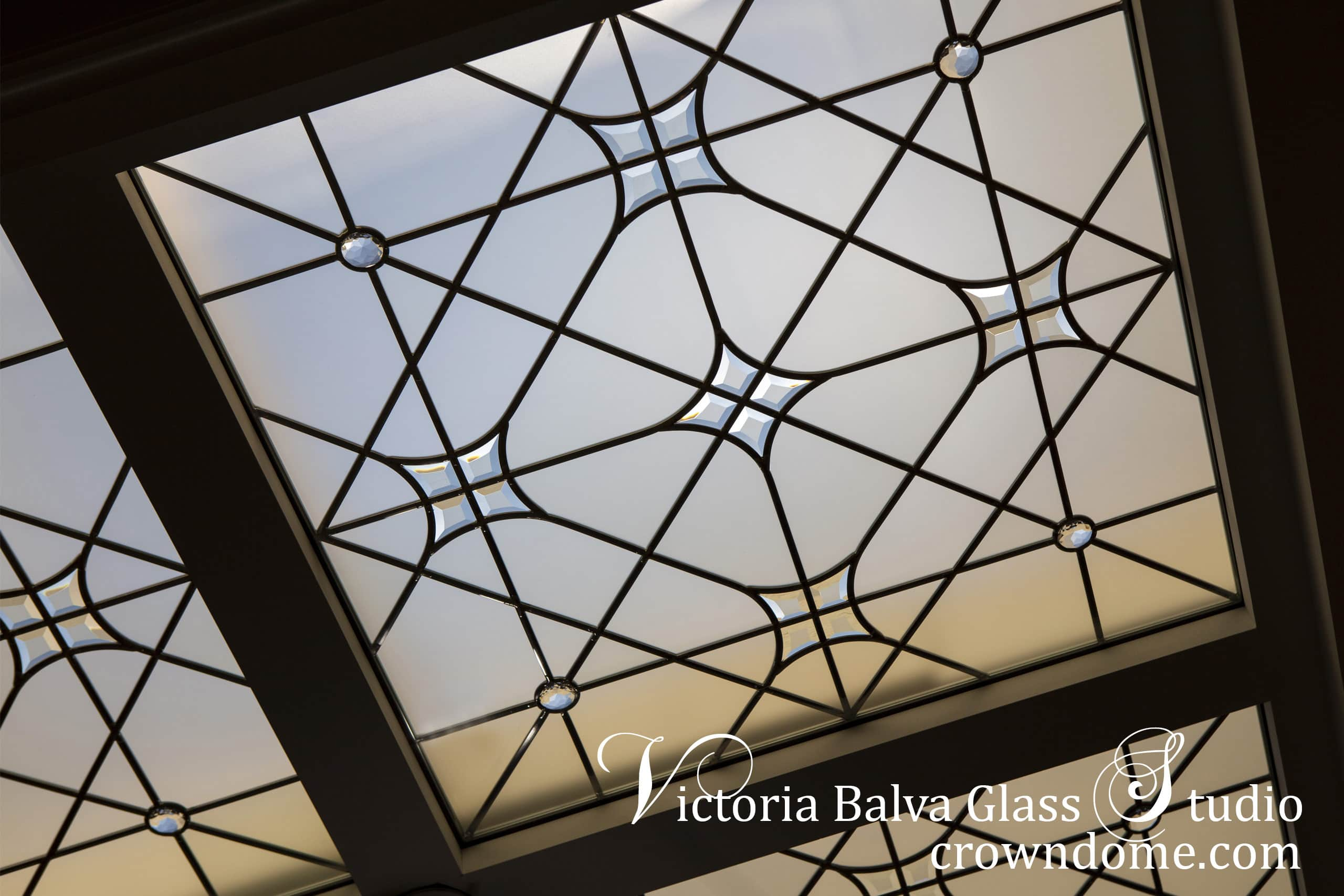 Large leaded glass skylight ceiling with hand bevelled glass and crystal jewels above the staircase with chandelier for a custom built luxury residence in Toronto