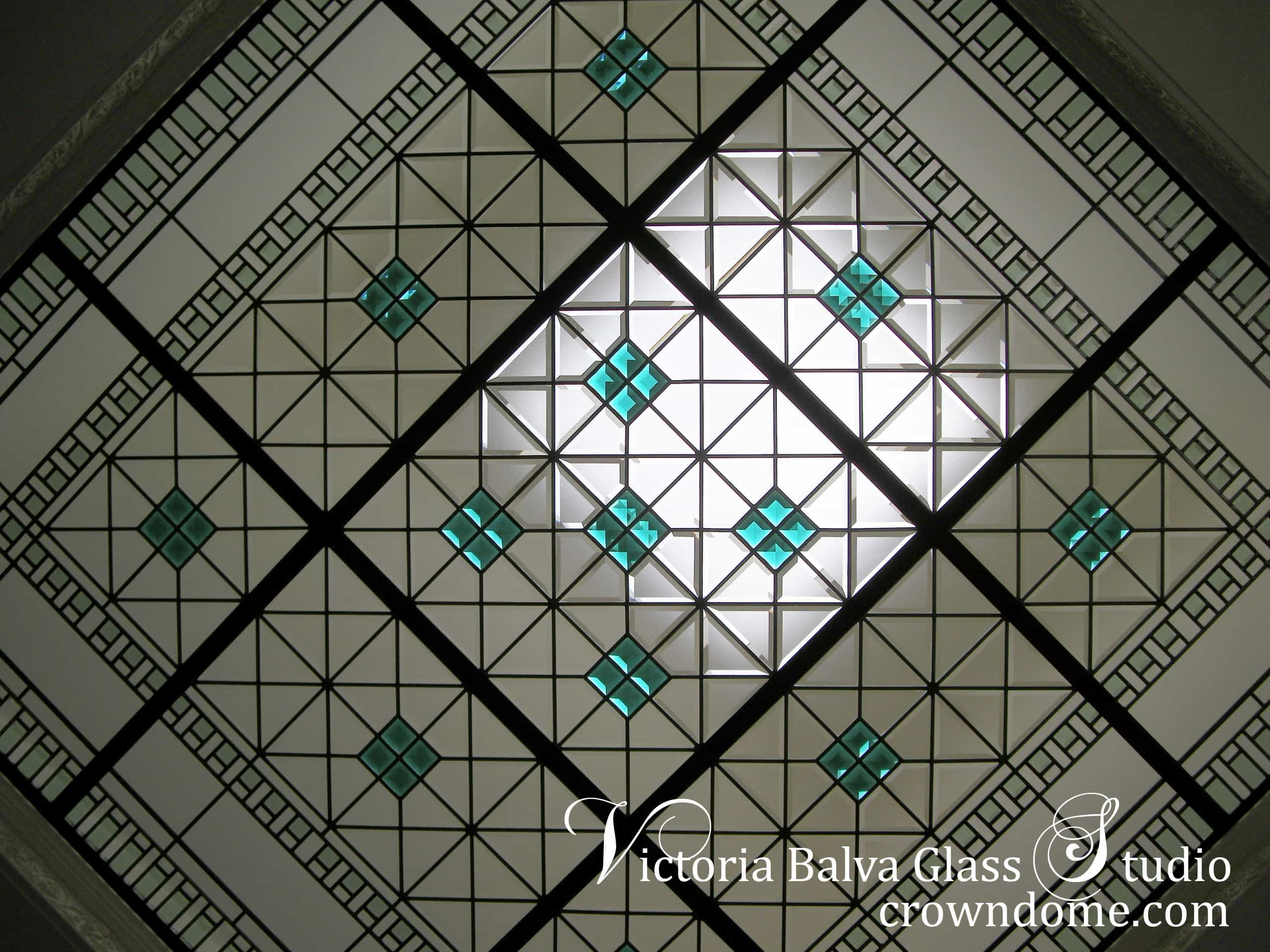 Contemporary geometric stained leaded glass skylight with custom beveled glass and large emerald jewels by stained glass artist Victoria Balva. Contemporary stained beveled leaded glass ceiling with emerald accent jewels and colored beveled glass for a custom built residence.