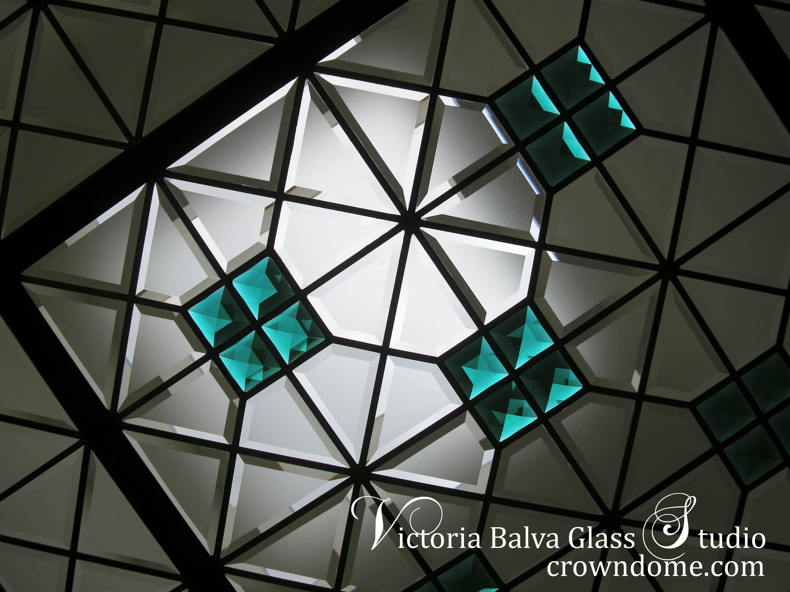 Extraordinary stained beveled leaded glass skylight ceiling with emerald accent jewels and colored beveled glass for a bathroom of a custom built residence. Simple geometric stained leaded glass design with custom beveled glass and large emerald jewels by stained glass artist Victoria Balva