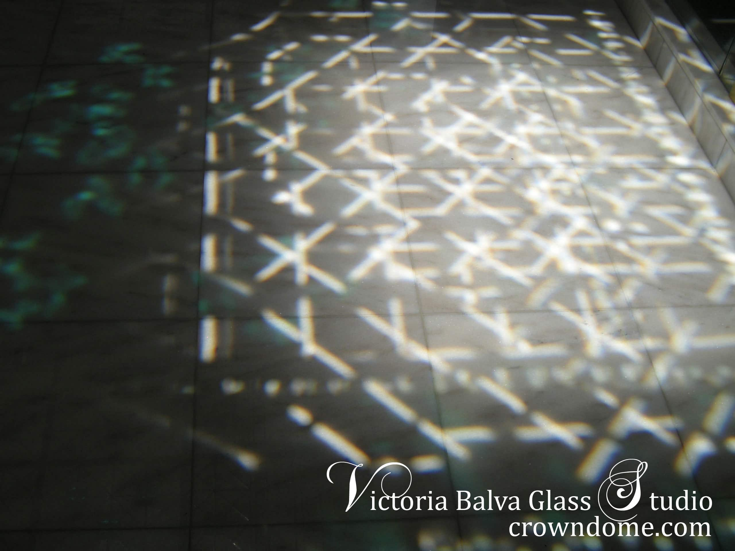 Beveled glass ceiling light show in the bathroom. Gorgeous bathroom stained beveled leaded glass skylight ceiling with emerald accent jewels and colored beveled glass for a bathroom of a custom built residence. Simple geometric stained leaded glass design with custom beveled glass and large emerald jewels by stained glass artist Victoria Balva