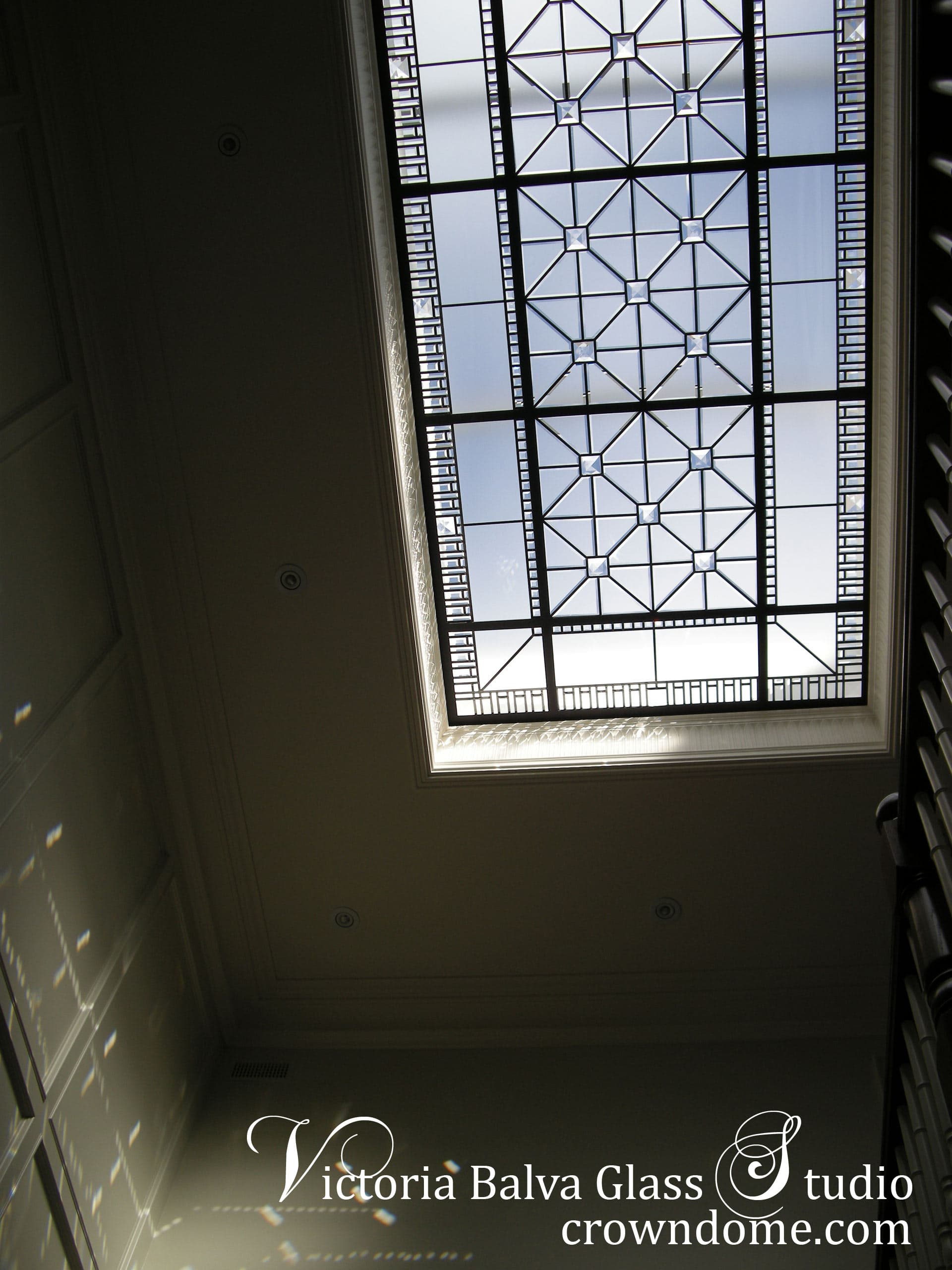 Geometric beveled leaded glass skylight design with custom beveling and large clear crystal jewels in simple geometric style for a hallway of luxury custom built residence in Toronto. Original beveled leaded glass skylight design by architectural glass artist Victoria Balva