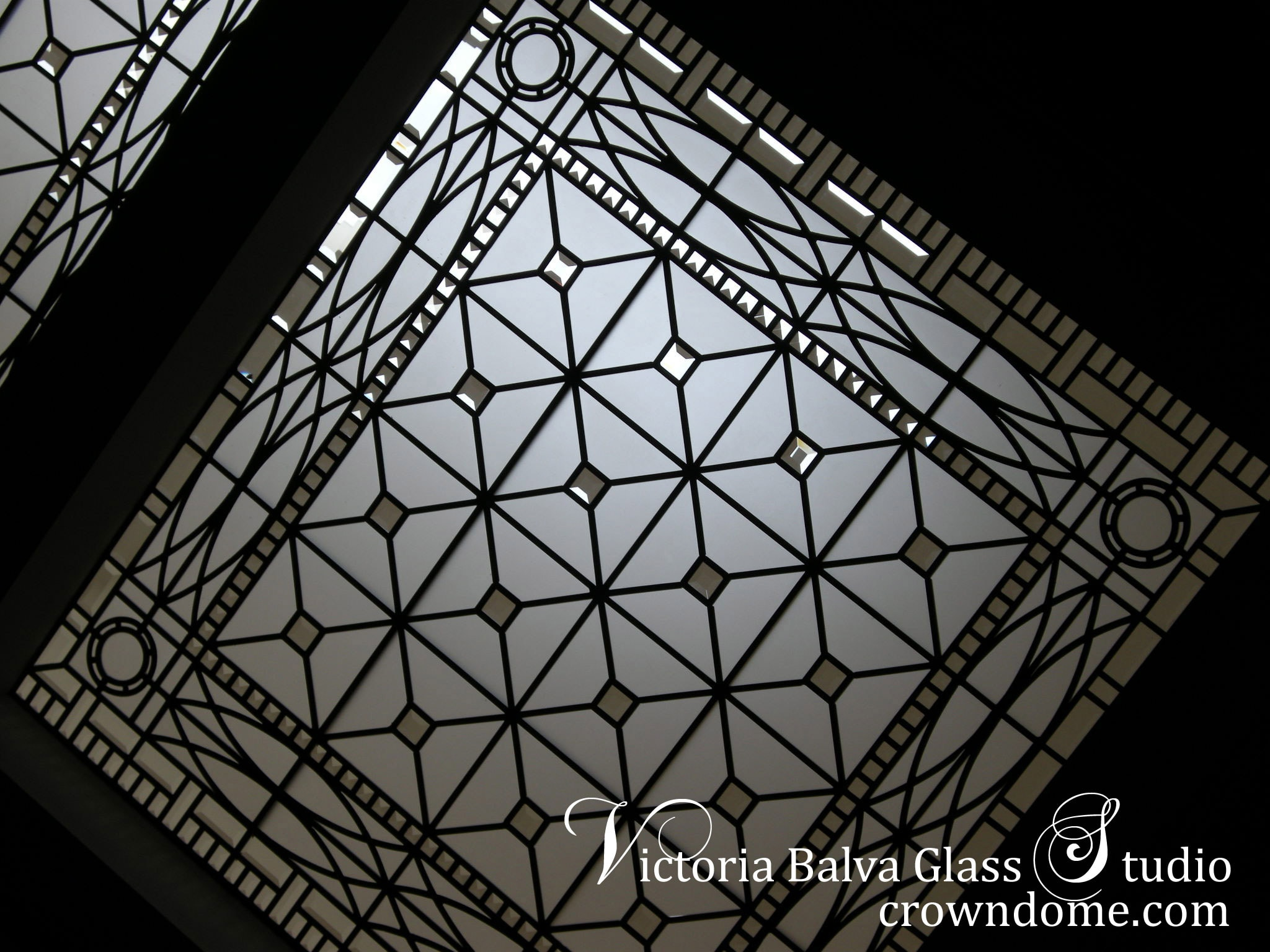 Triple beveled leaded glass skylight Hogg's Hollow for a custom built residence in Toronto. Silk and velvet in acid etched glass and clear beveled glass. Leaded glass design by glass artist Victoria Balva