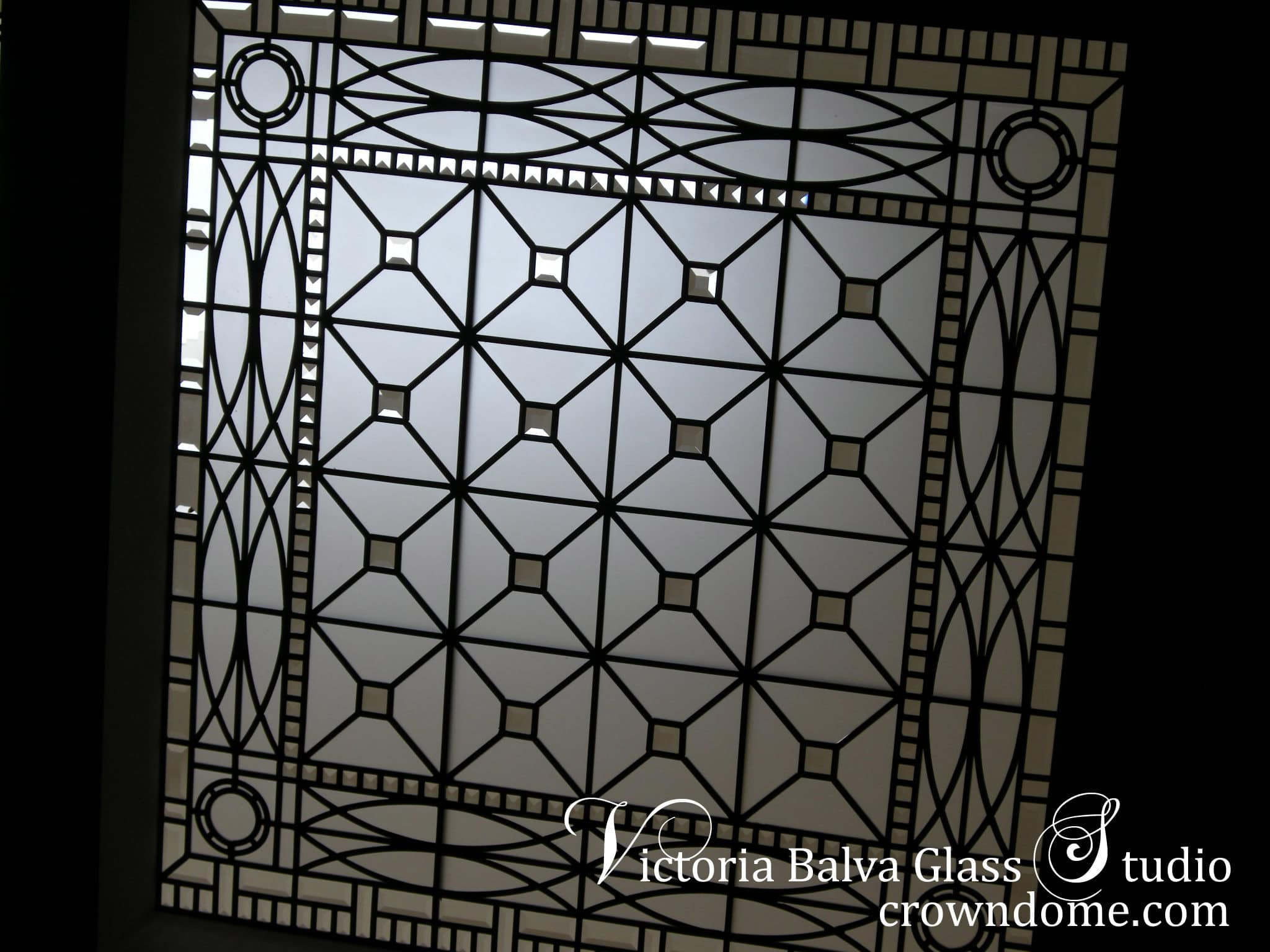 Triple beveled leaded glass skylight ceiling Hogg's Hollow for a custom built residence in Toronto. Silk and velvet in acid etched glass and clear beveled glass. Leaded glass ceiling skylight design by glass artist Victoria Balva