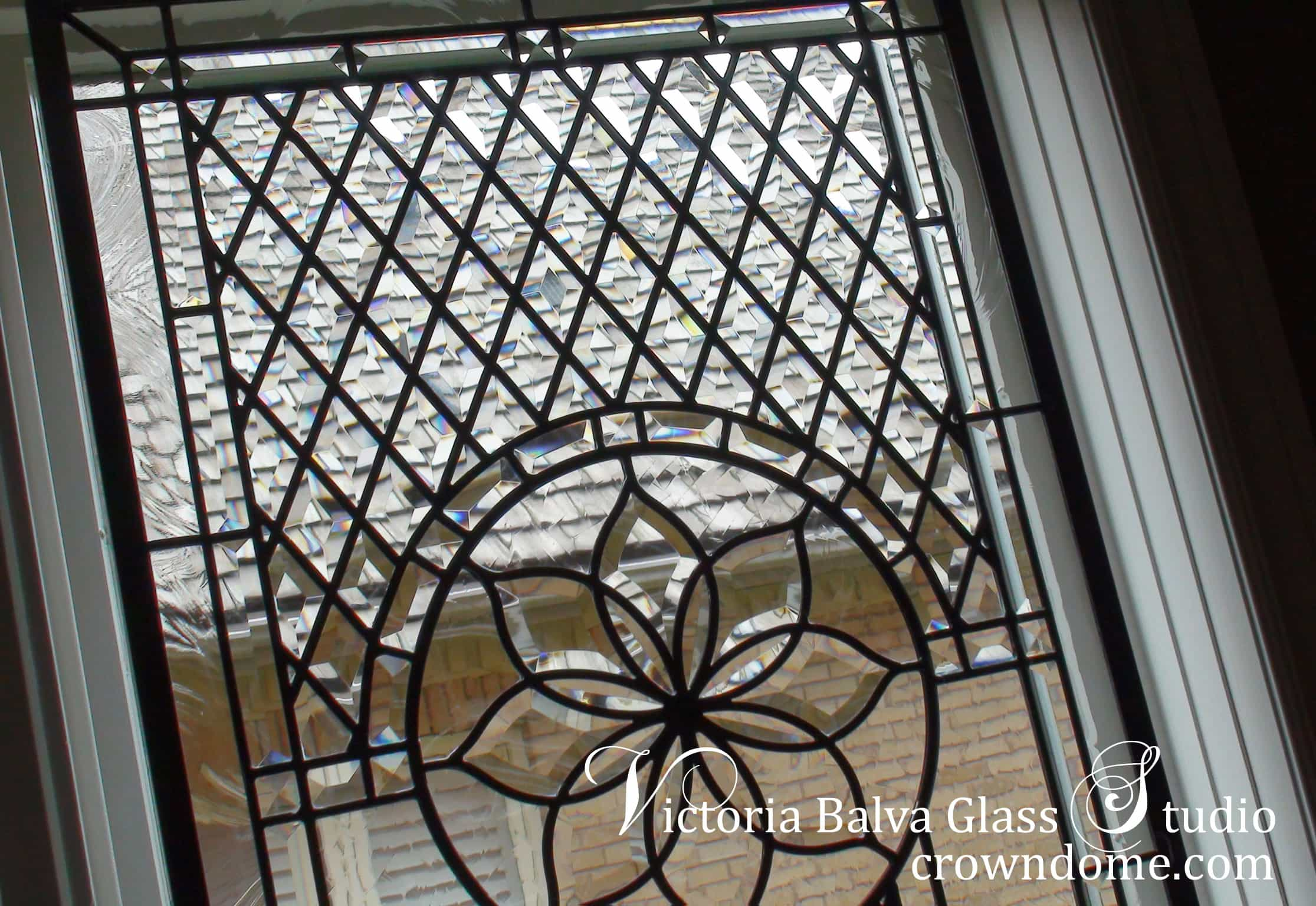Custom beveled leaded glass window design for a dining room of a private house to add privacy and beauty to space. Clear beveled glass, intricate line work design by glass artist Victoria Balva