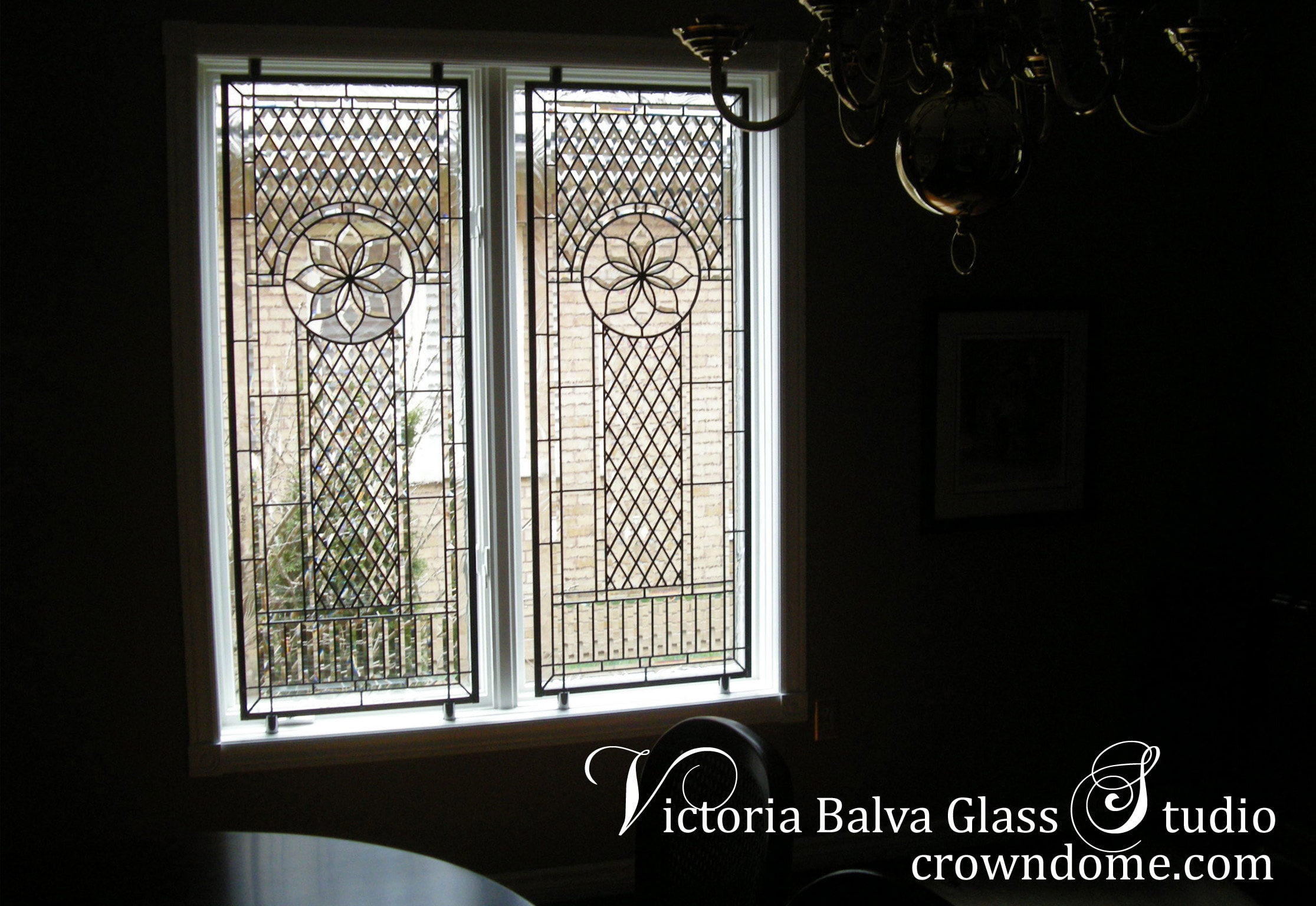 Double classic beveled leaded glass window after installation for a dining room of a private residence to add privacy and beauty to space. Clear beveled glass, textured architectural glass, intricate line work design by stained glass artist Victoria Balva