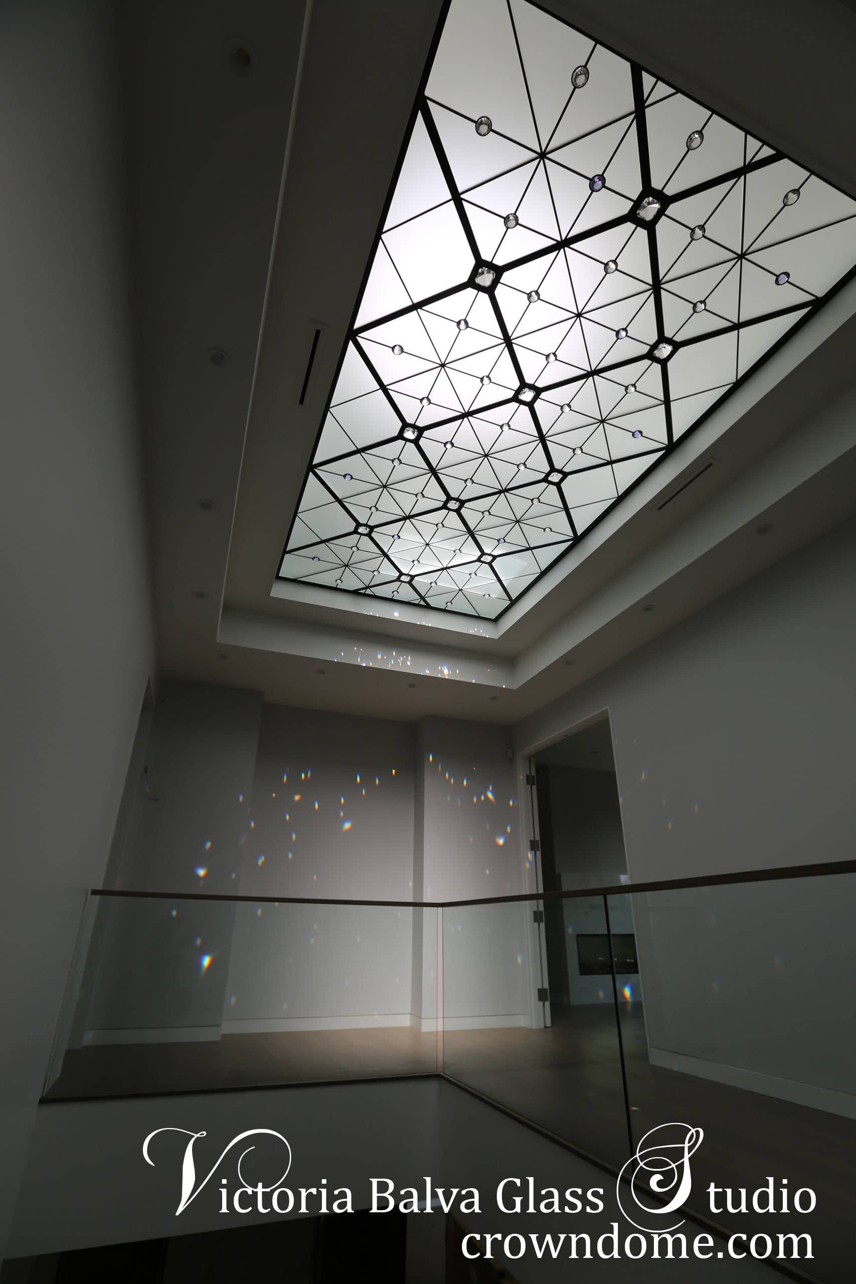 Contemporary stained glass skylight in minimalistic style for a staircase of a custom built residence in Toronto