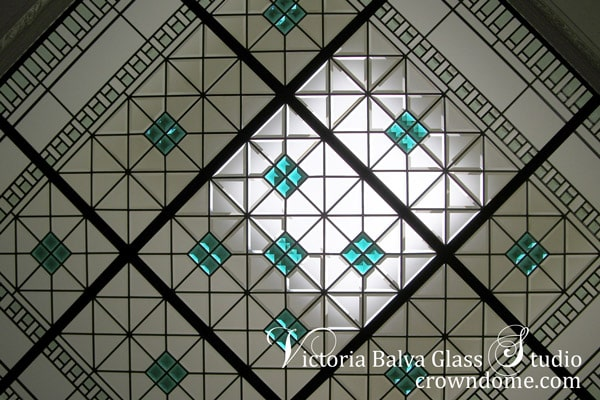 Cstom hand beveled stained leaded glass skylight ceiling with colored bevelled glass and emerald jewels for a master bathroom of a luxury custom built house