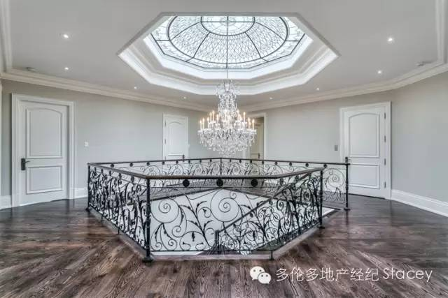 Custom designed octagon stained glass domed skylight with crystal chandelier above the staircase of custom-built residence in Vaughan