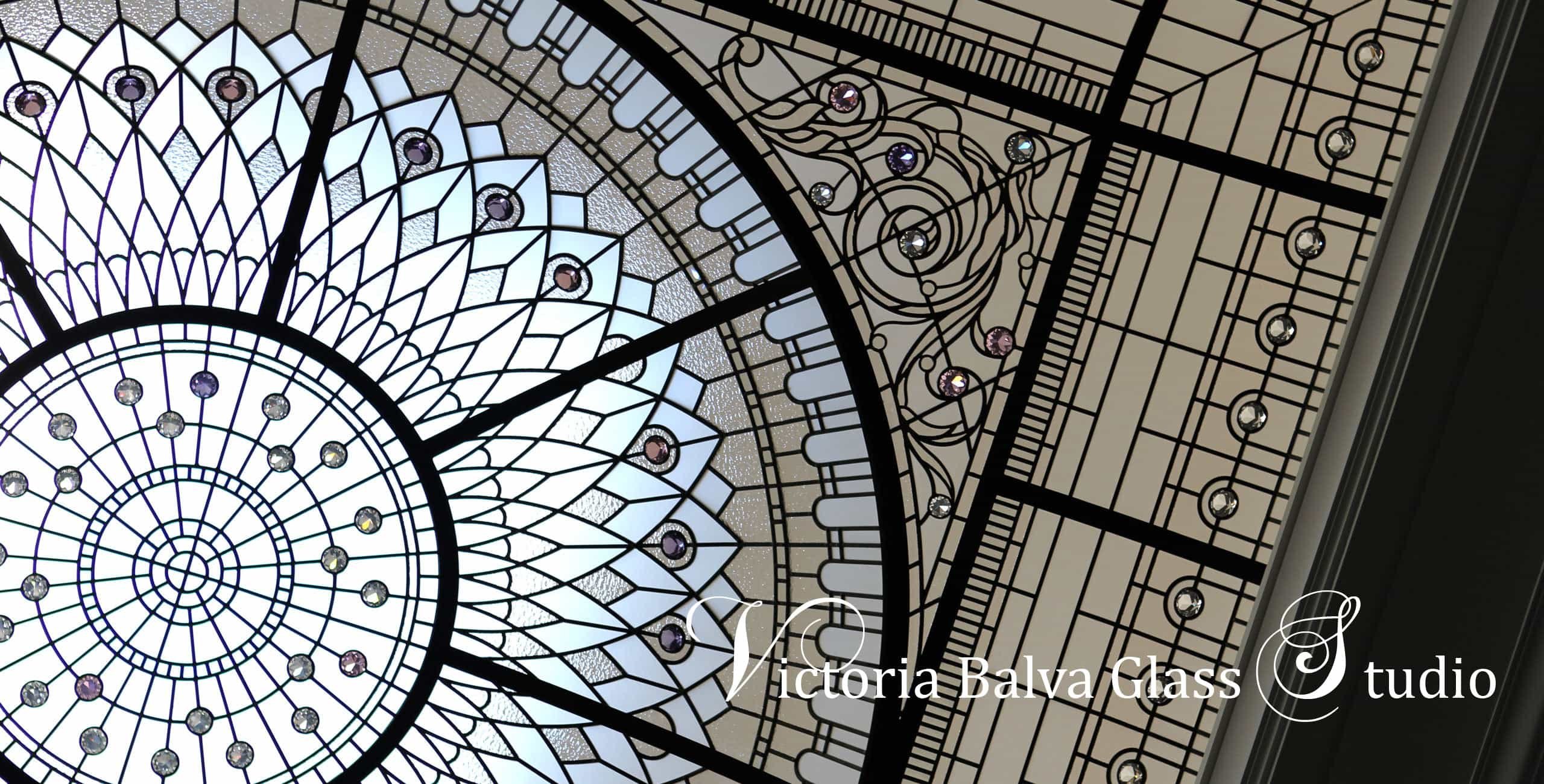 Custom stained leaded glass domed skylight inspired Hotel Plaza glass ceiling for custom built residential home. Classical design entrance hall with large decorative glass ceiling domed skylight custom designed by glass artist Victoria Balva